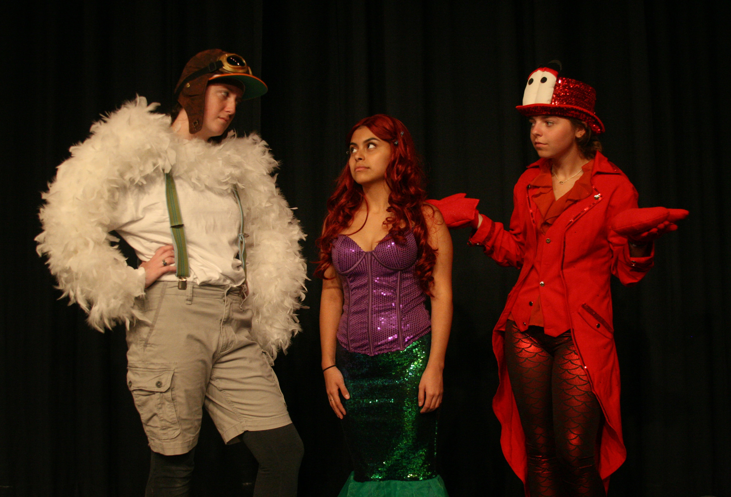 Scuttle the seagull (Jennifer Henderson) and Sebastian the crab (Lindley Andrew) try to persuade Ariel (Jennifer Trejo Benitez) that life is better under the sea.