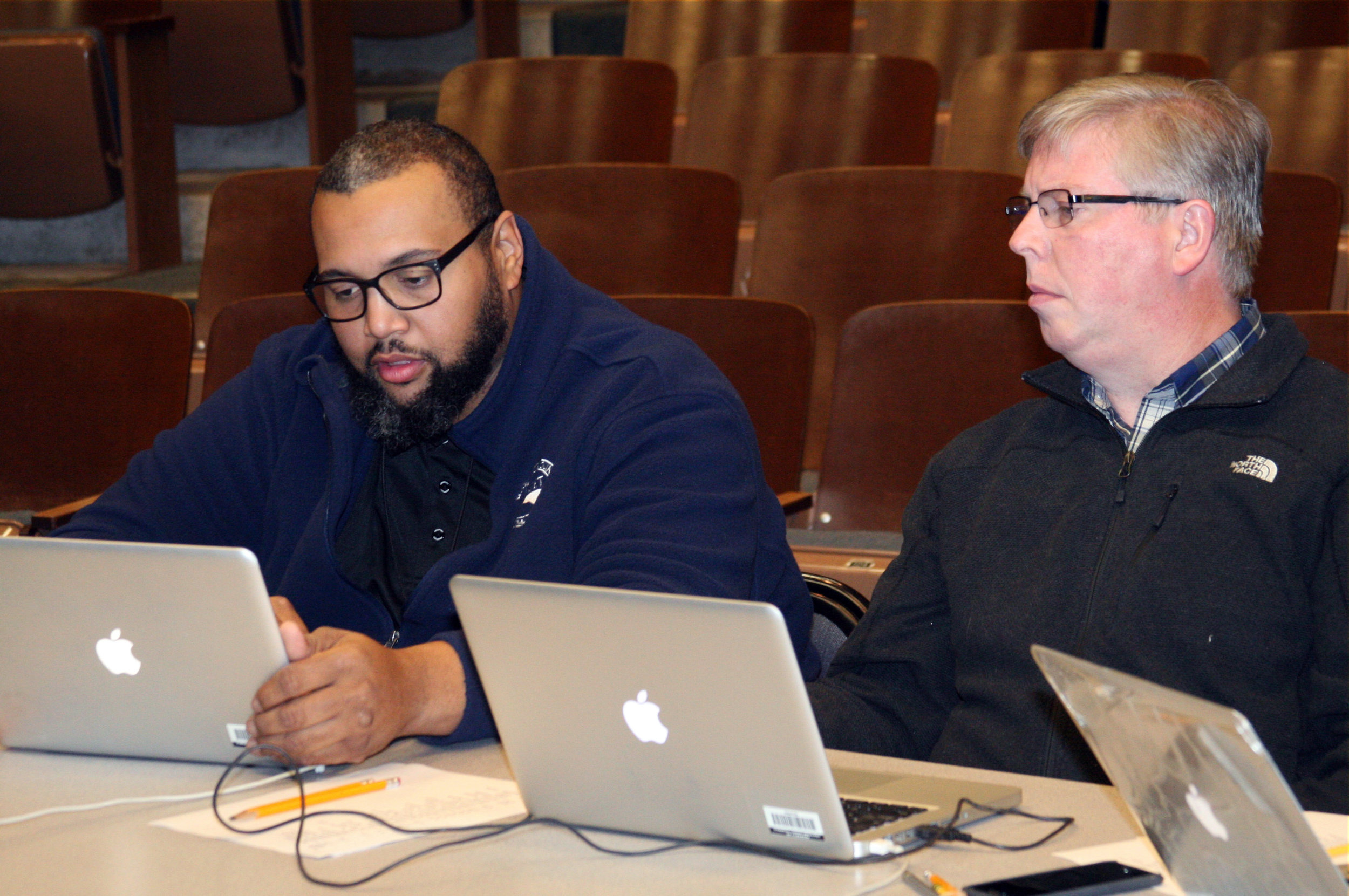 Greg Burriss, right, consults with Joey Walden while judging auditions during Sing and Play '18 in February. Burriss has been named director of Sing and Play '19, the second-annual musical competition scheduled for February at Jordan-Matthews High School.