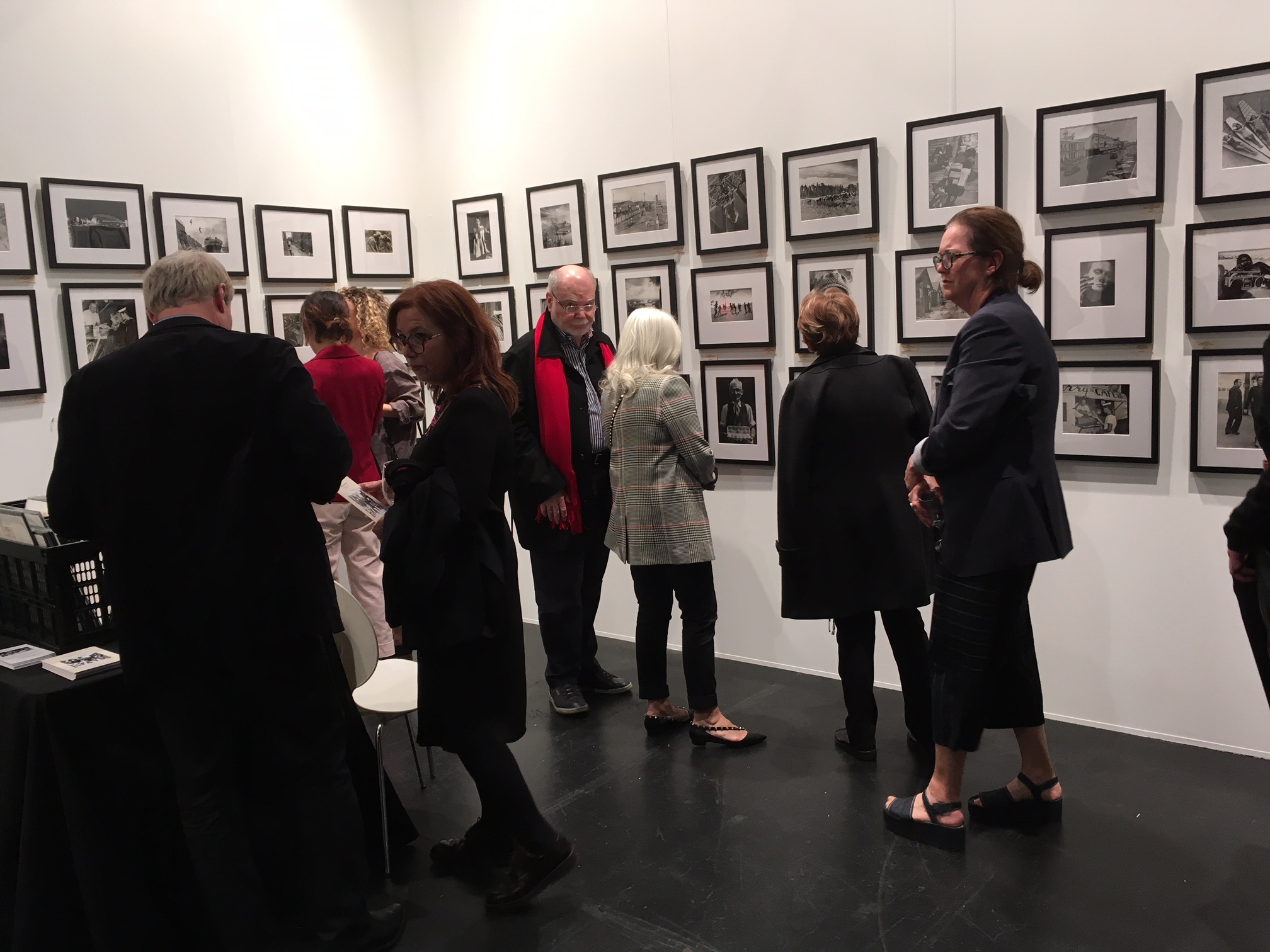 HomeToAustralia.org presents vintage photographs in its busy booth at Sydney Contemporary.