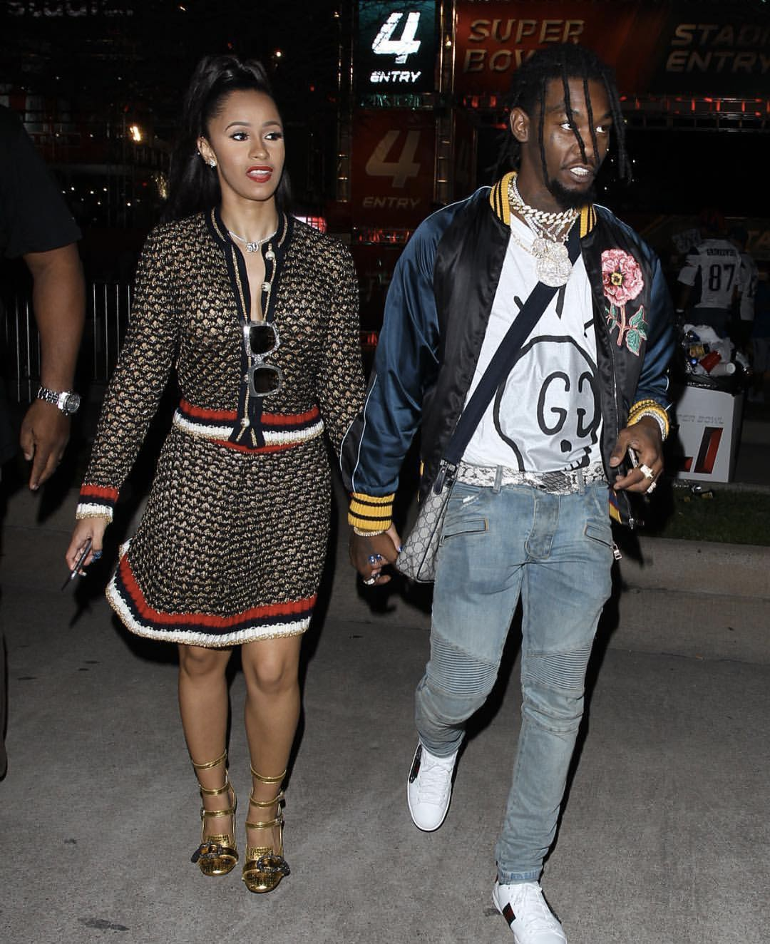 (via: Looklive)    Cardi B spotted with Migos member Offset in a Gucci Lurex Blend matching set