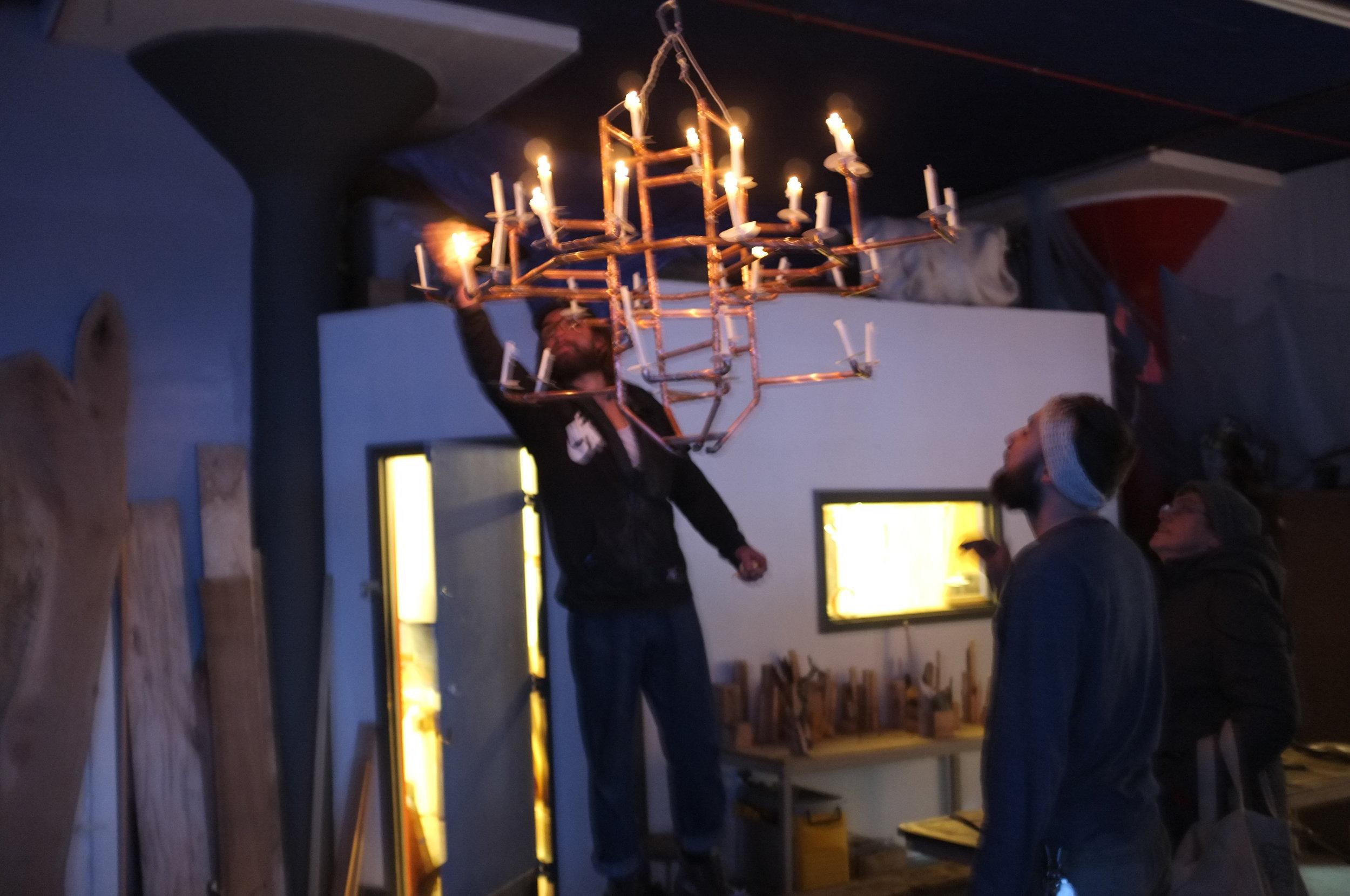 Greg lighting the chandelier