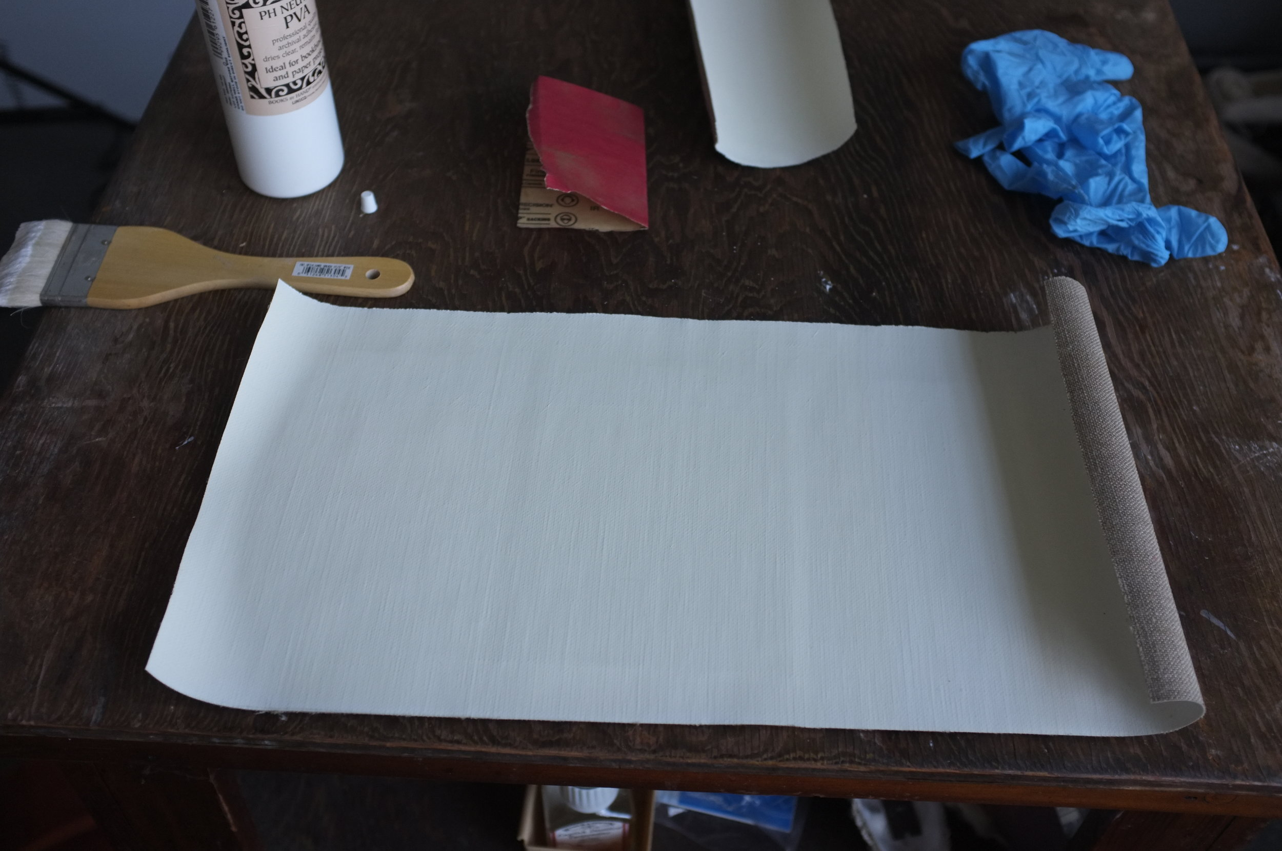 The linen is rolled on top and firmly pressed down.