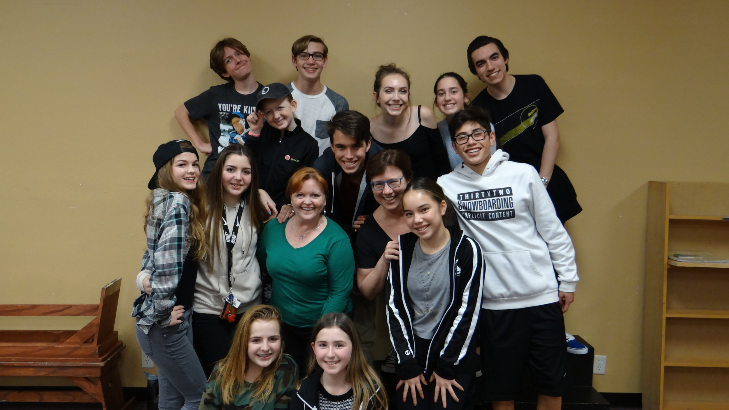 Shauna Markey and Take the Stage owner Bethany Price surrounded by some of the Working Pro Teen students.