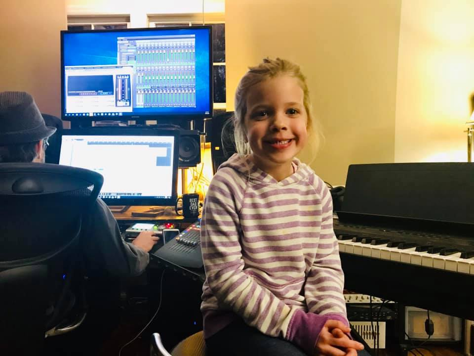 grins from my youngest while we edit a track…