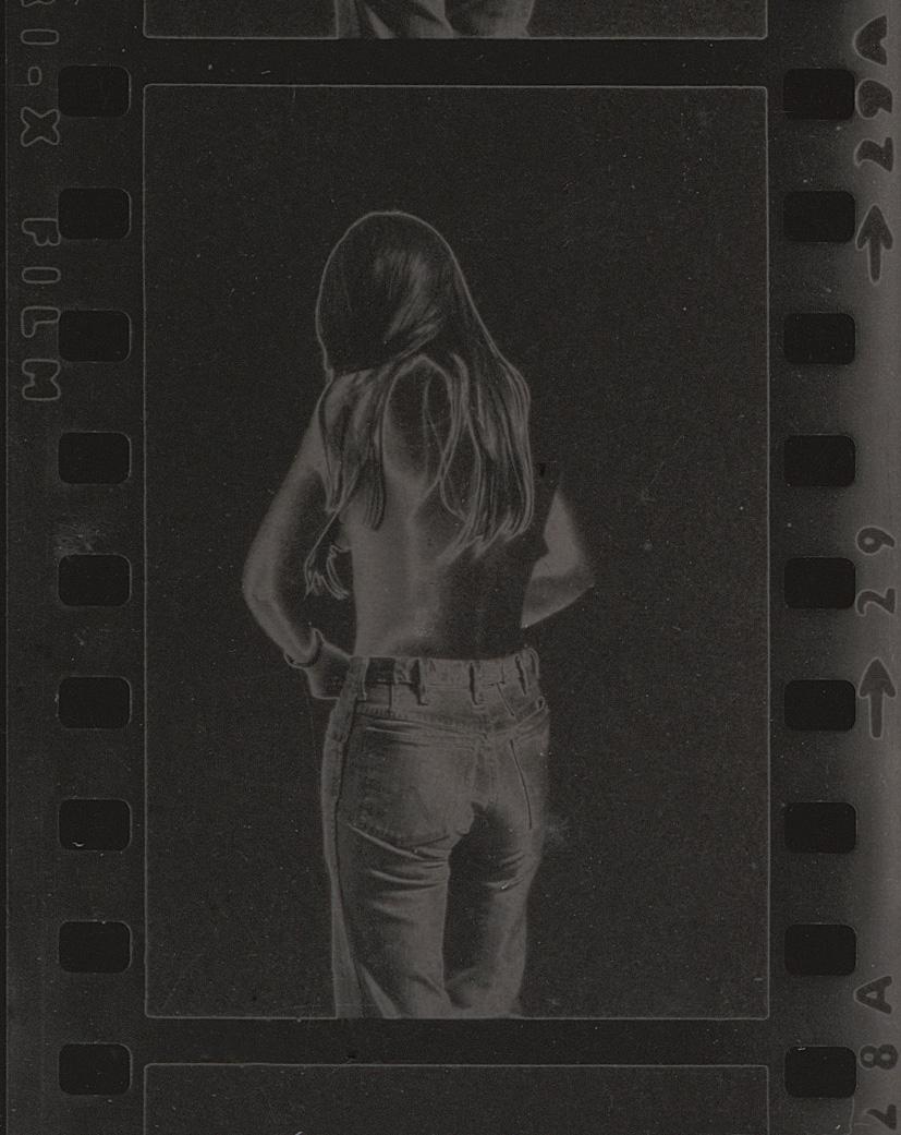 Sherie Undressing (Tri-x), solarized silver gelatin print