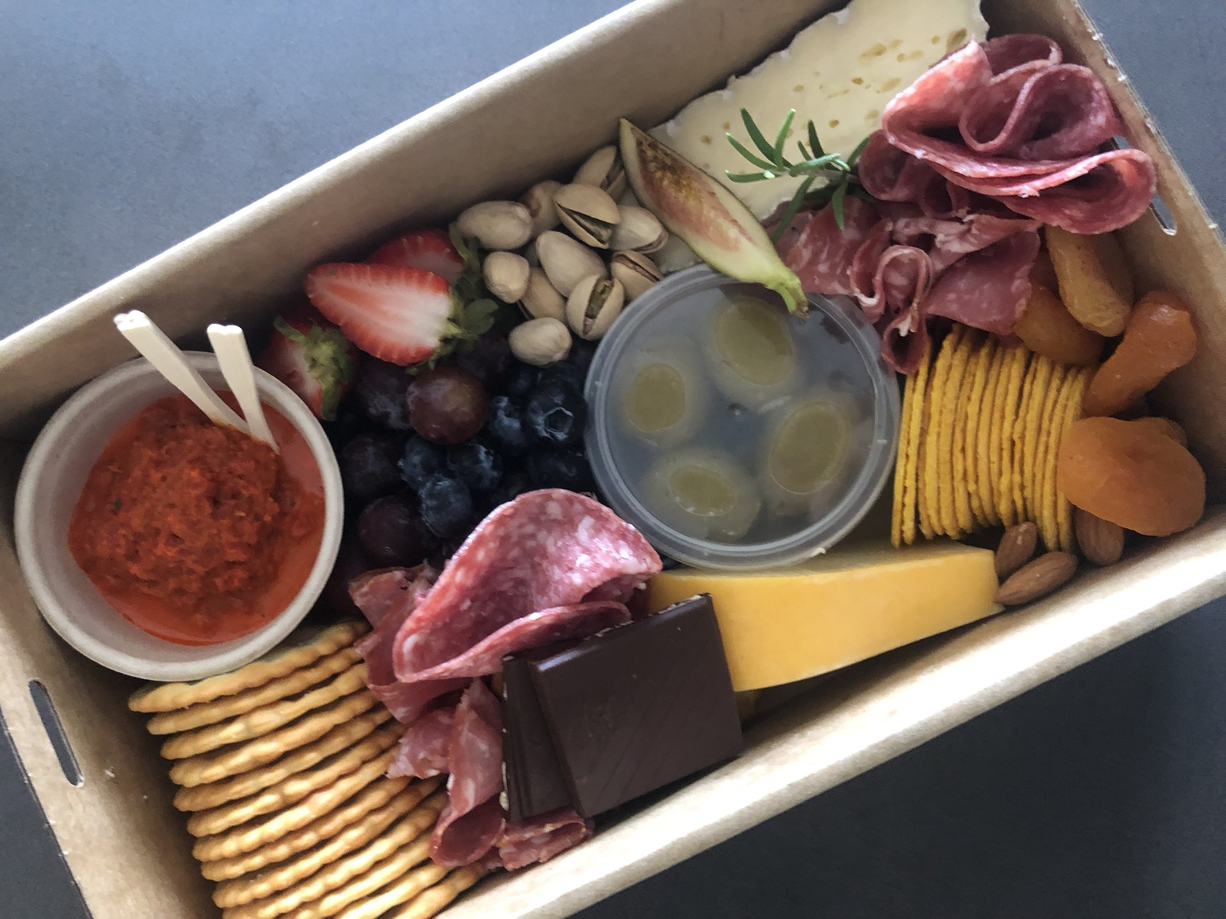 SMALL PLATTER BOX$50.00 - perfect grazing for 1 - 2 people(box size is 15 x 25cm)Filled with an assortment of cheese and delicious dips, crackers, cured meats, assortment of fresh seasonal fruit, nuts, with a touch of something sweet. Garnished with fresh rosemary from our grandma's garden.