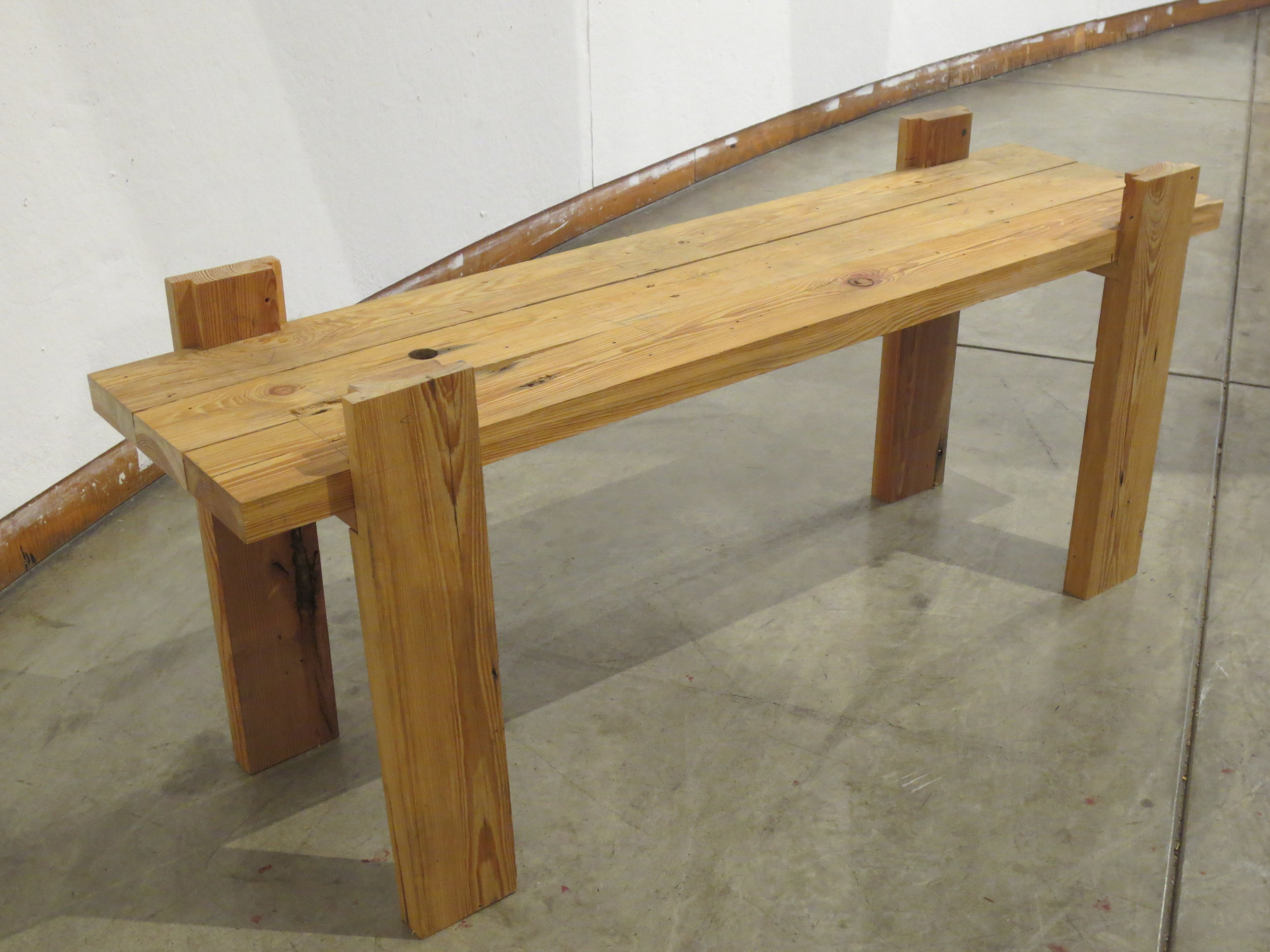 Dovetail-jointed bench, constructed by hand-saw without glue or hardware.