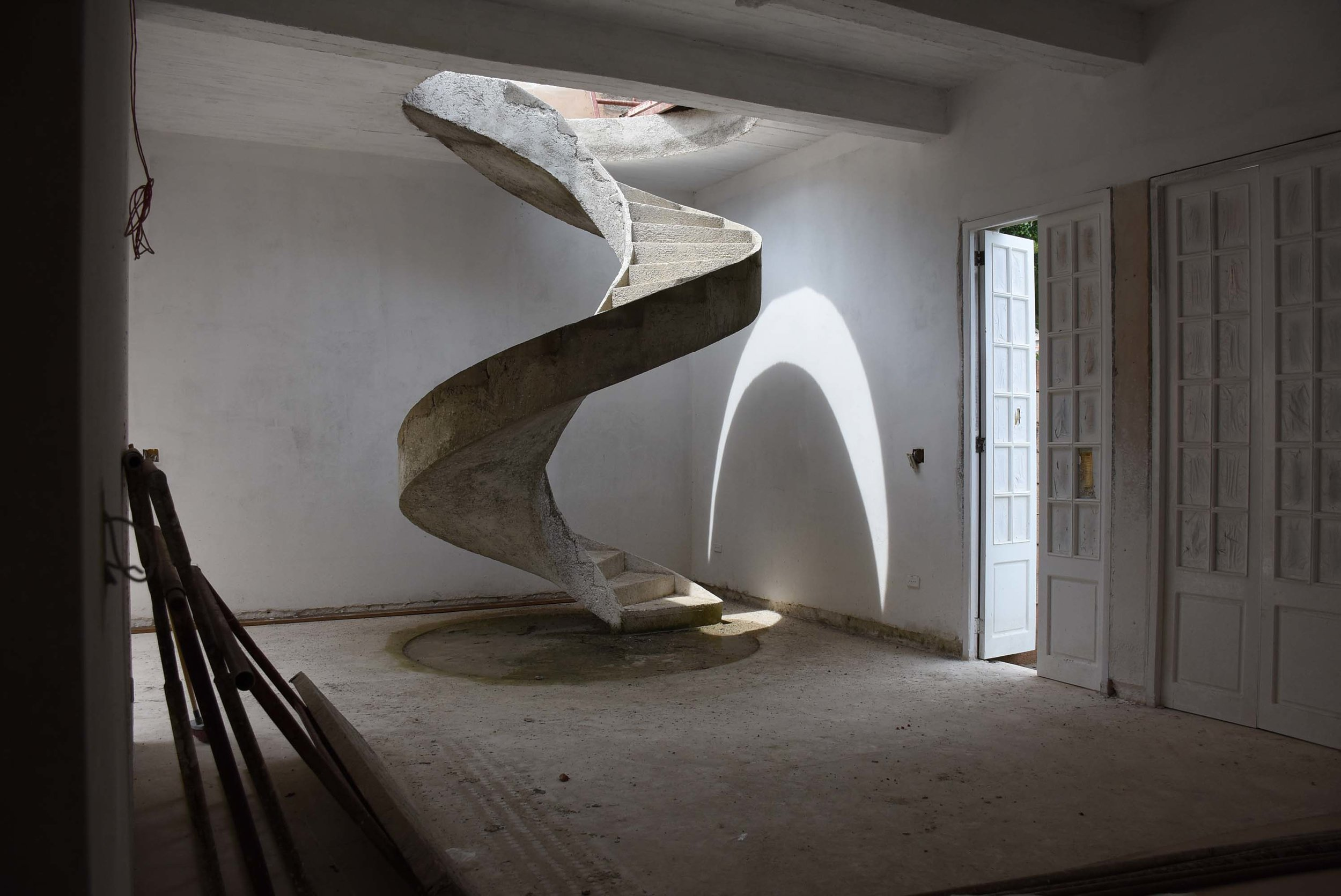 Cast-in-place concrete staircase in house under renovation by independent architect, Miramar, Havana, 2017.