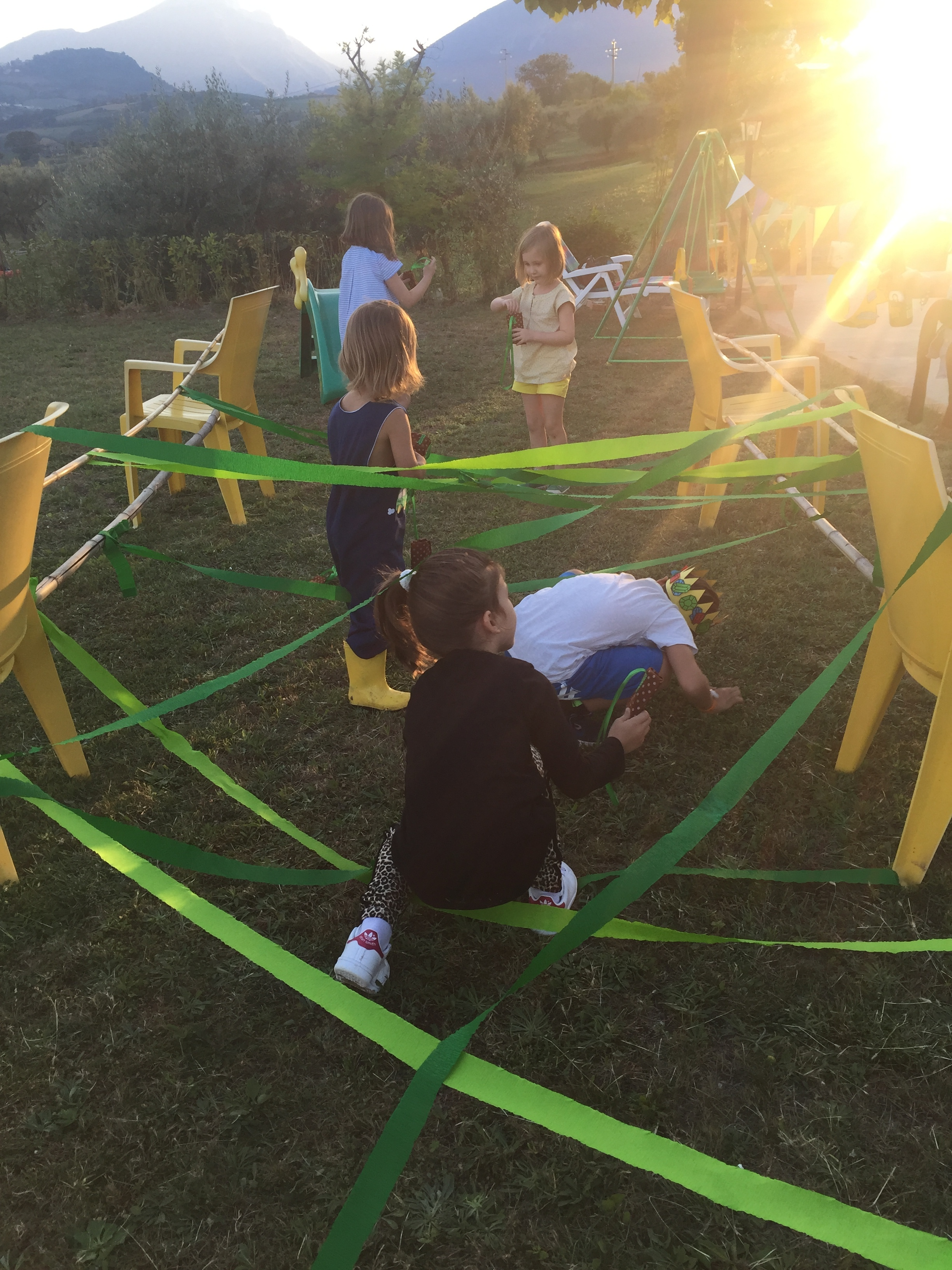 The kids going through our simple laser maze to find their pouches full of stones.