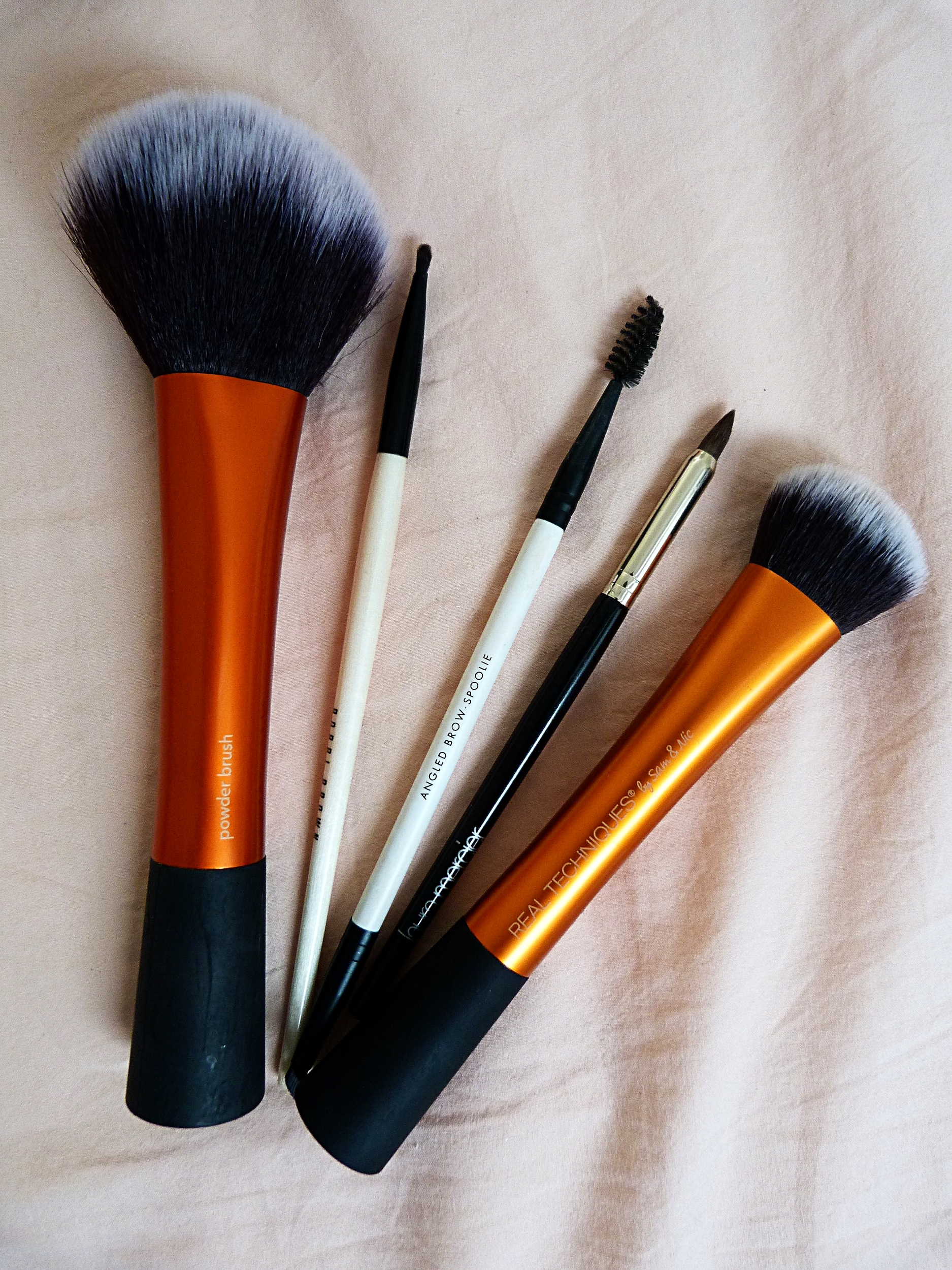 Left to Right      Real Techniques Powder Brush       Bobbi Brown Fine Eye Liner Brush      Lily Lolo Spoolie Brush      Laura Mercier Smoky Liner Brush      Real Techniques Expert Face Brush