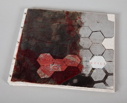 Still - 2012.Artist Book with wrap: book board, silk-screened & dyed organza silk, xerox transfer prints, salvaged papers, Cave paper, sumi ink, wire, thread.8.25 x 8.13 x .33 inches