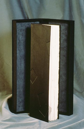 Black & Blank - 1989.Artist Book with Clamshell Box: Multi-signature with split board binding, Coptic chain stitch & silk cover made with book board, silk, paper, thread, sumi ink, 24K gold leaf, gouache.5.25 x 15.5 x .635 inches
