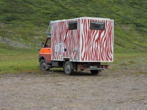 camper by glacier