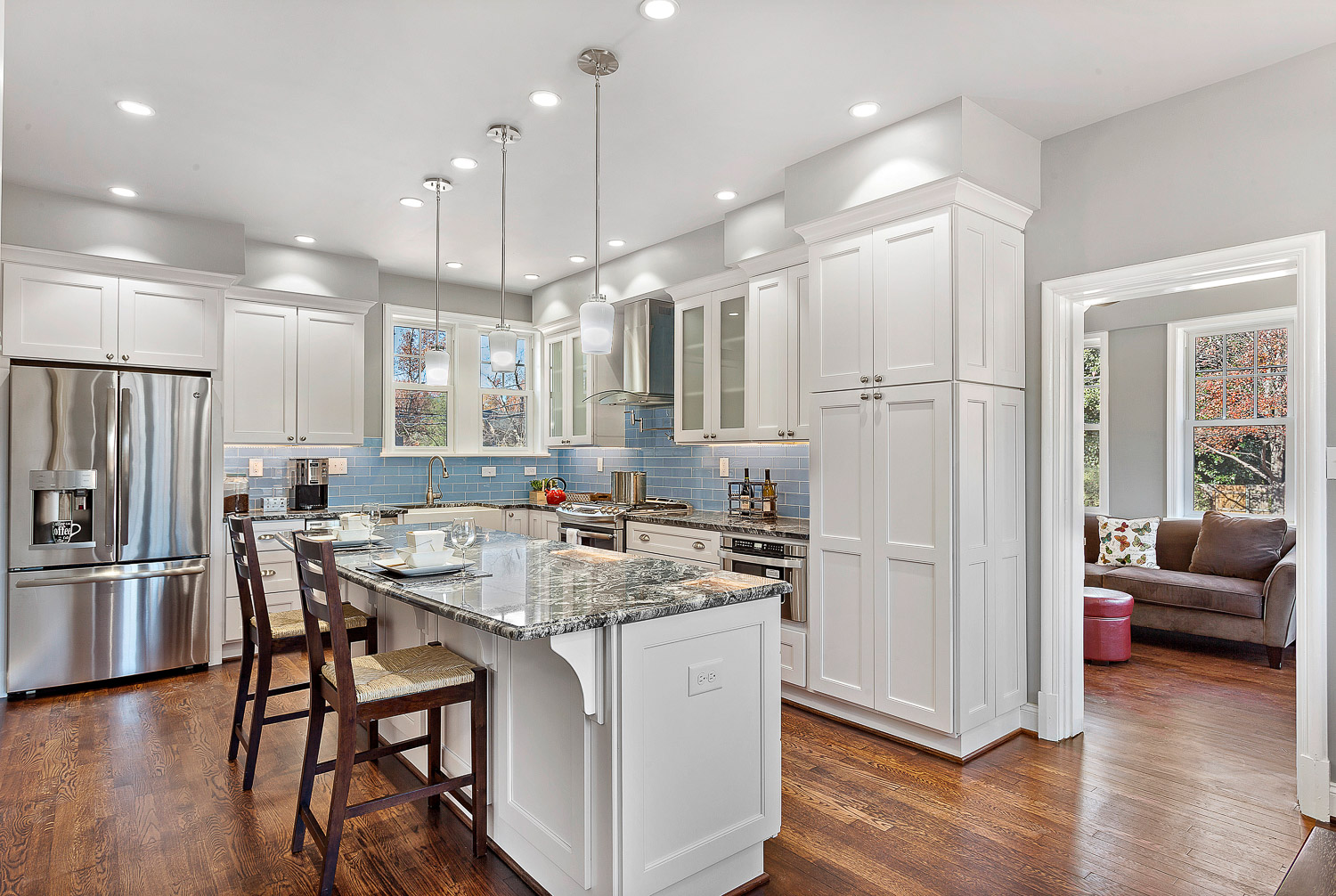 Custom White Kitchen with Blue Subway Tile and Granite and Hardwood Floors