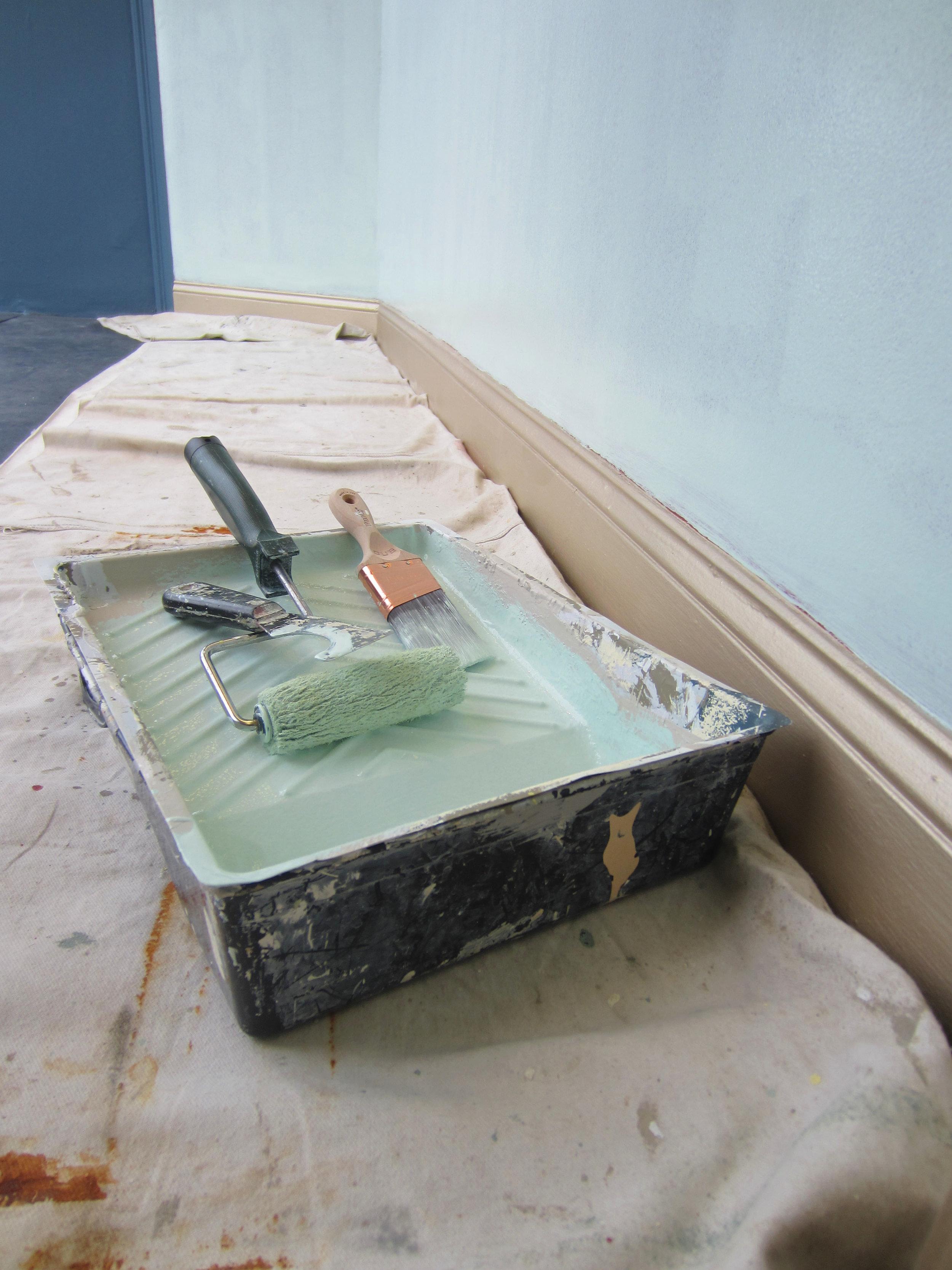 Paint roller in paint pail