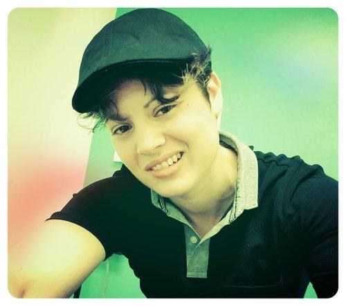 Me! Collared henley-type shirt, newsies cap, boyish hair, soft grin: my teaching aesthetic!