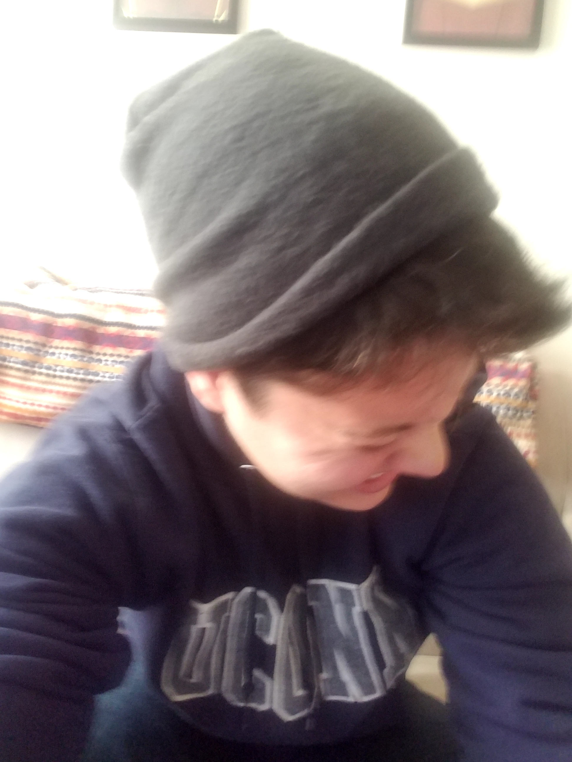 ^^ This one, I love. No one is crying, shhhhh. I'm laughing, but this time more of my beanie than my face is visible because I'm looking down and away. The smile is still extremely crinkly.