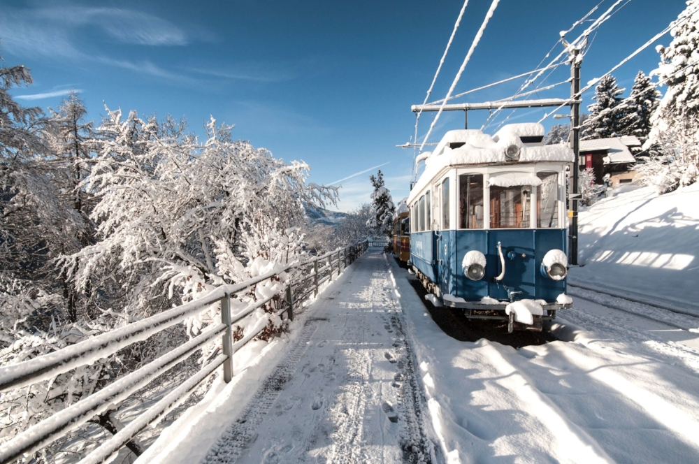 Train in snow Switzerland