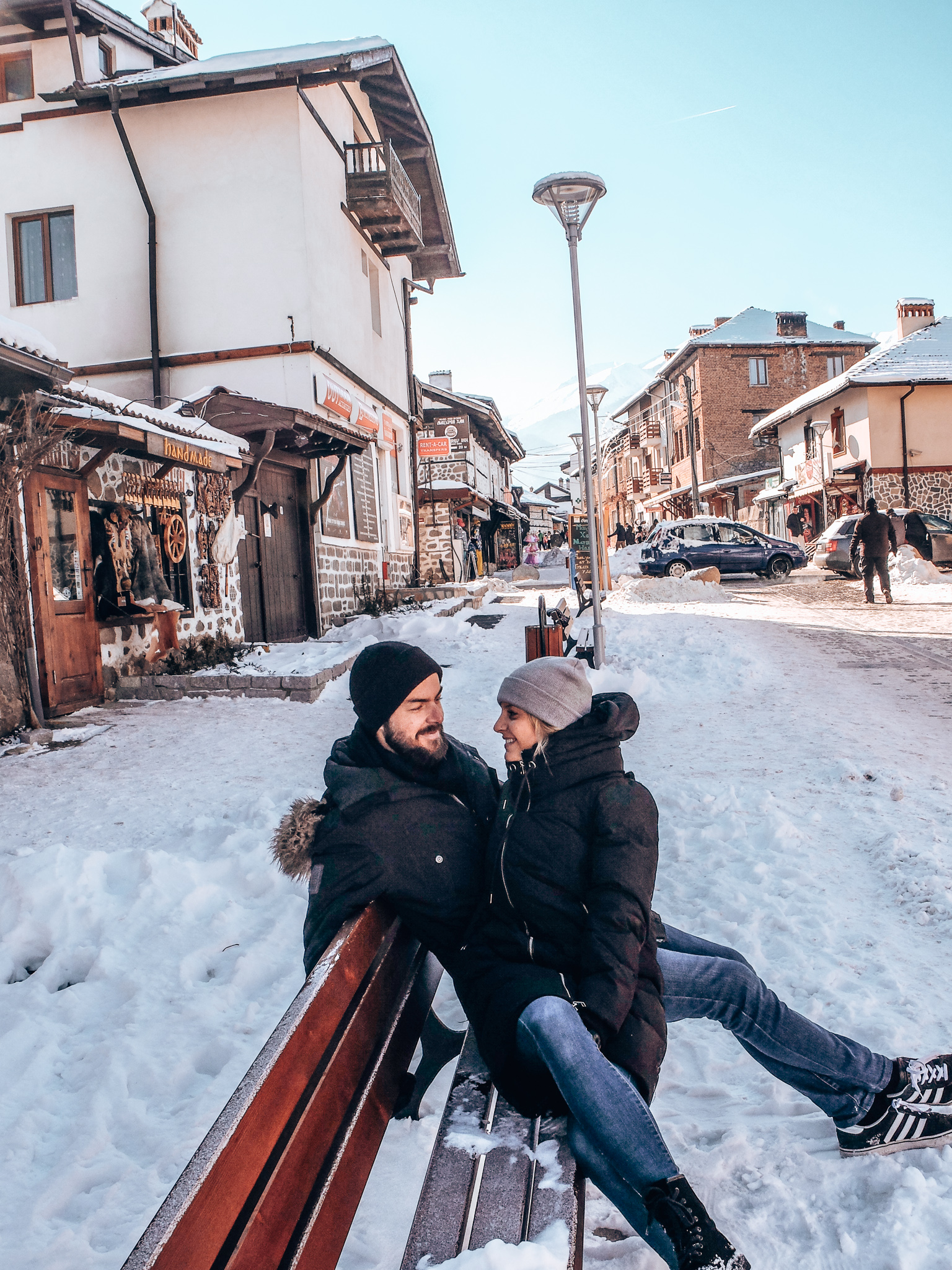 Bansko - couple smiling at each other on bench