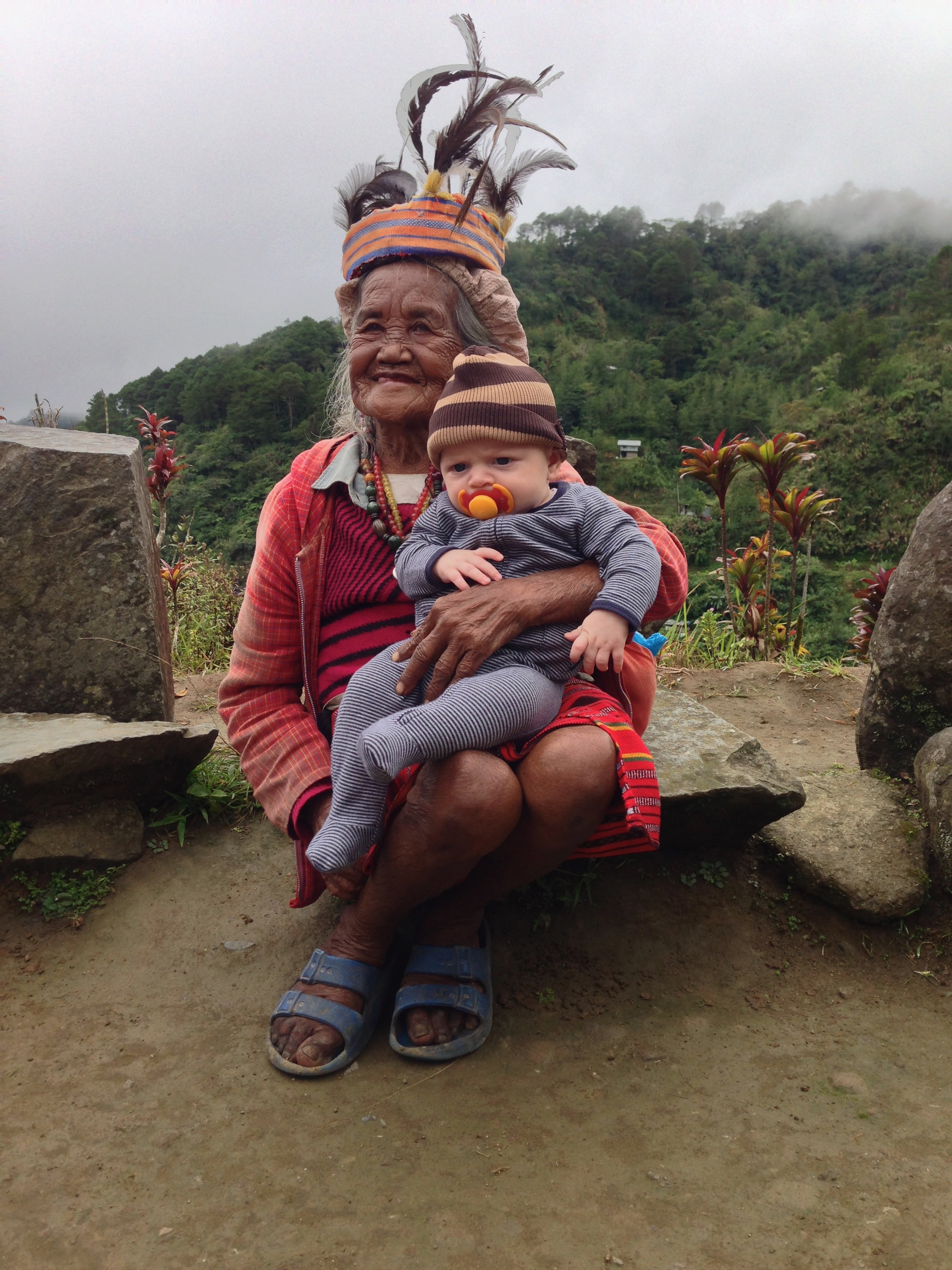 - Baby Oz 6 weeks old with an Ifugao woman in the Northern province of Banaue.