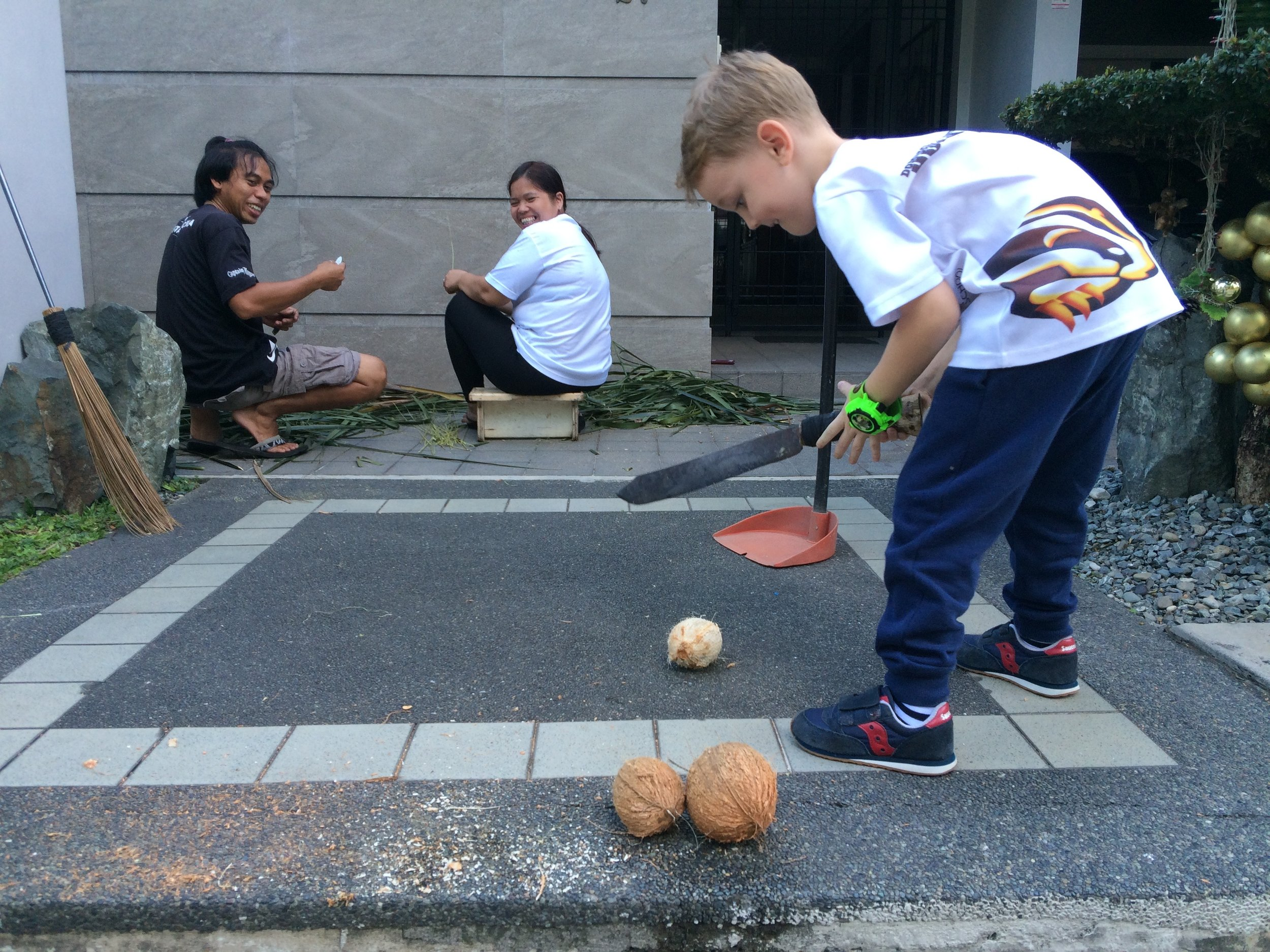 - When in the Philippines...let your child open a coconut with a machete.
