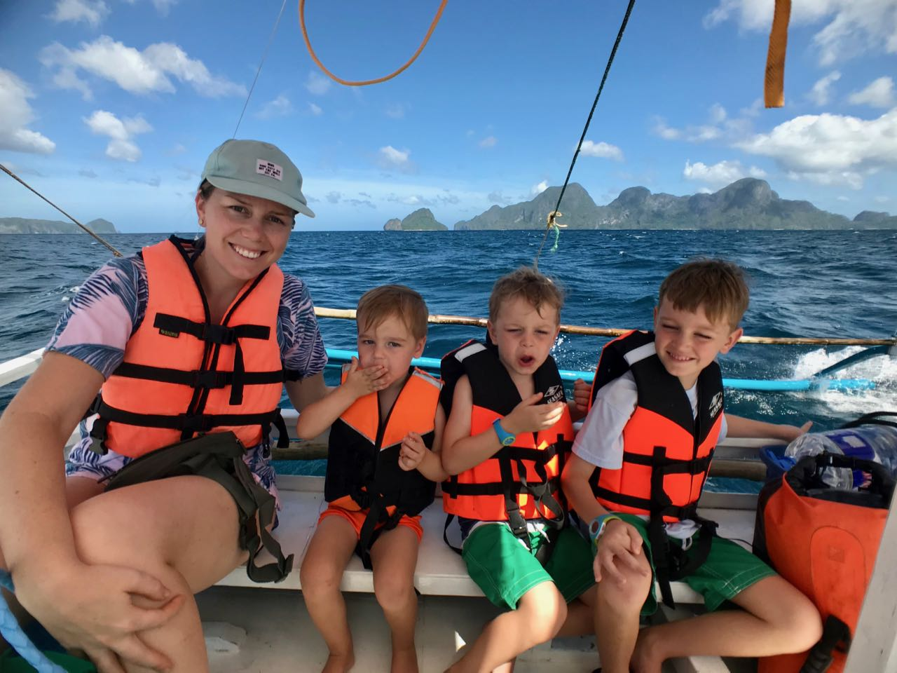 boys on boat + mom.jpg