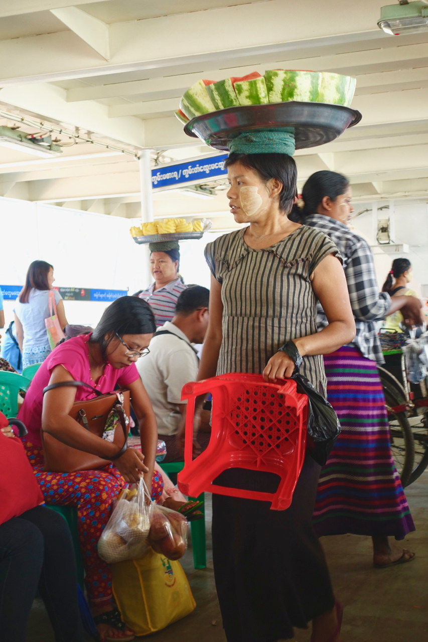 Each vendor has their own call. The chant is loud and together, they create a chorus of Myanmar. -