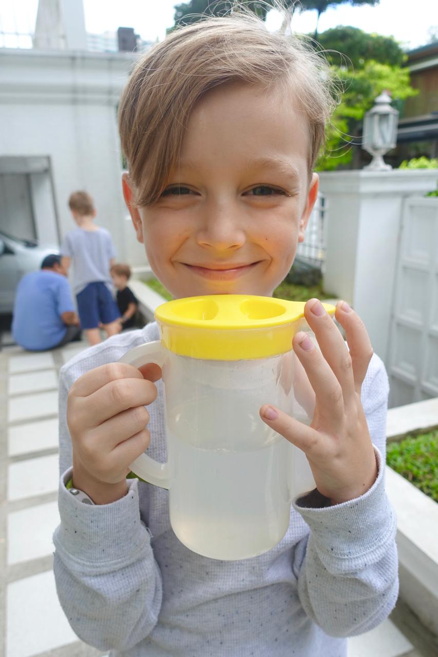 My proud Pinoy boy with his buko juice -