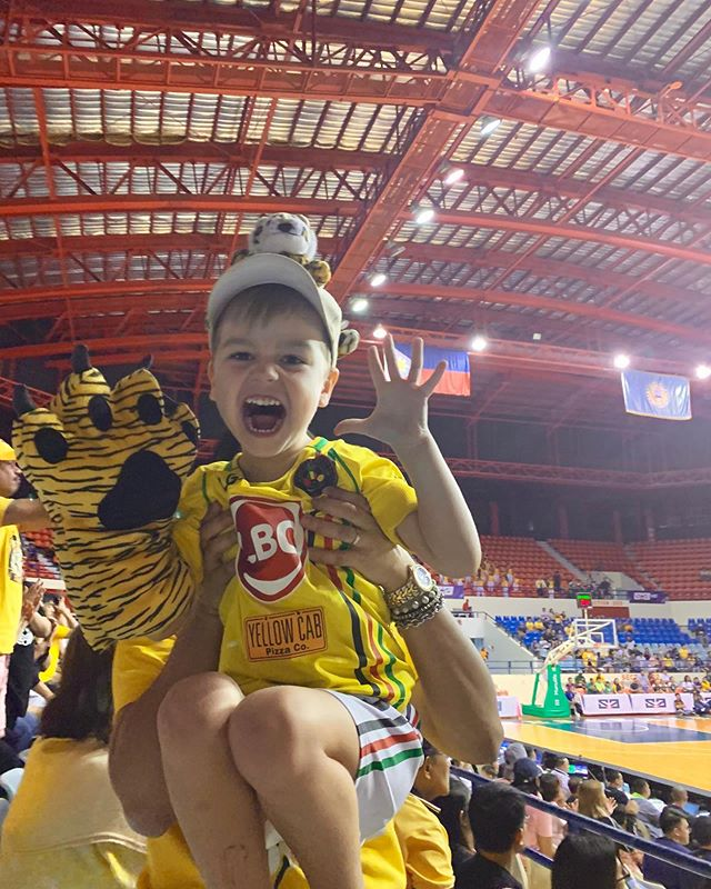 ROAR! 🐯My ferocious UST Tiger tonight at the UAAP game. 🐯 The great thing about our family, we aren't tied to any specific team. 🏀 If you invite us to a game we will show up wearing whatever color you ask us too. 😅 We are loving this new window into Filipino culture and cannot get enough of these games. #perksofpinas #FolkFam2019