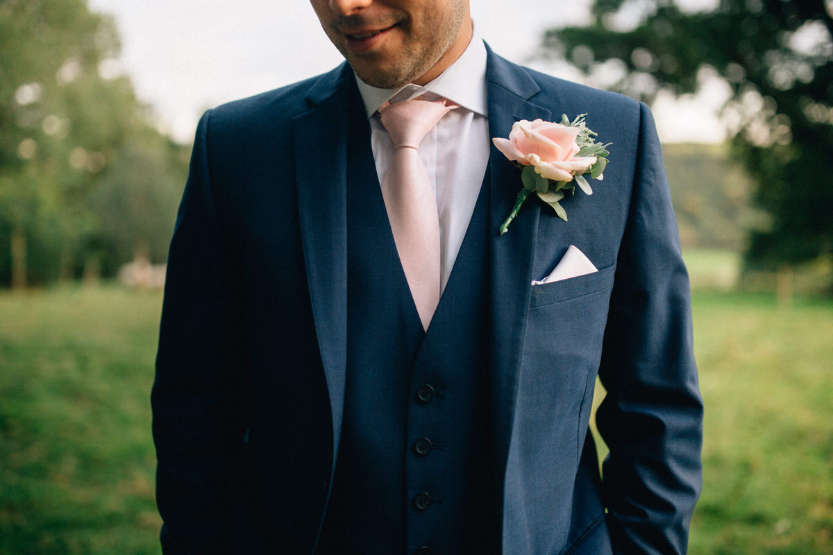 Image from:  https://joseph-hall.com/exeter-wedding-photography-pynes-house/24-groom-pink-tie-buttonhole/