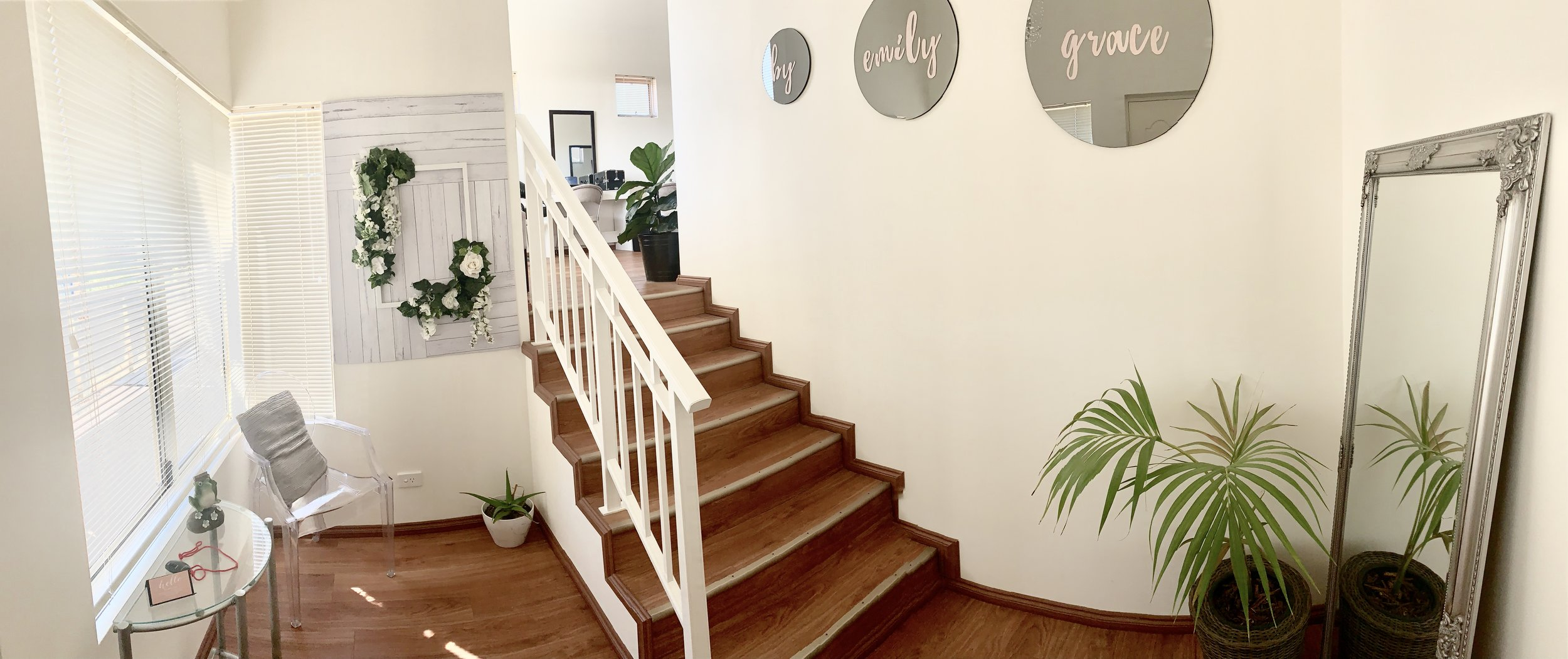 The front entrance of our studio, seen once you've entered through the front door. You then proceed up the stairs seen in the above image to the main room of our studio.