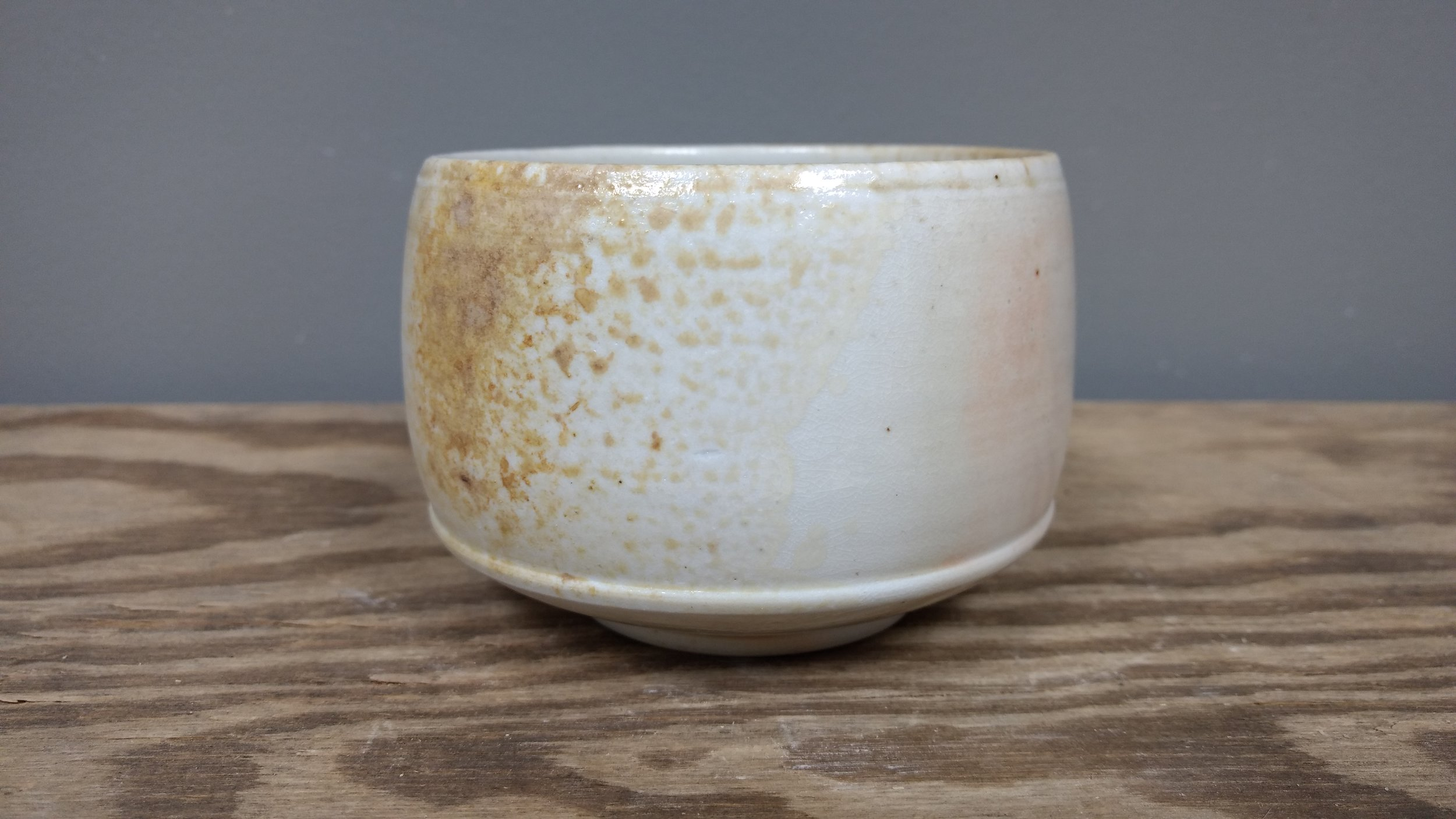 "Yunomi $42   Wood fired Porcelain Diameter- 4"" Height- 3.5"""