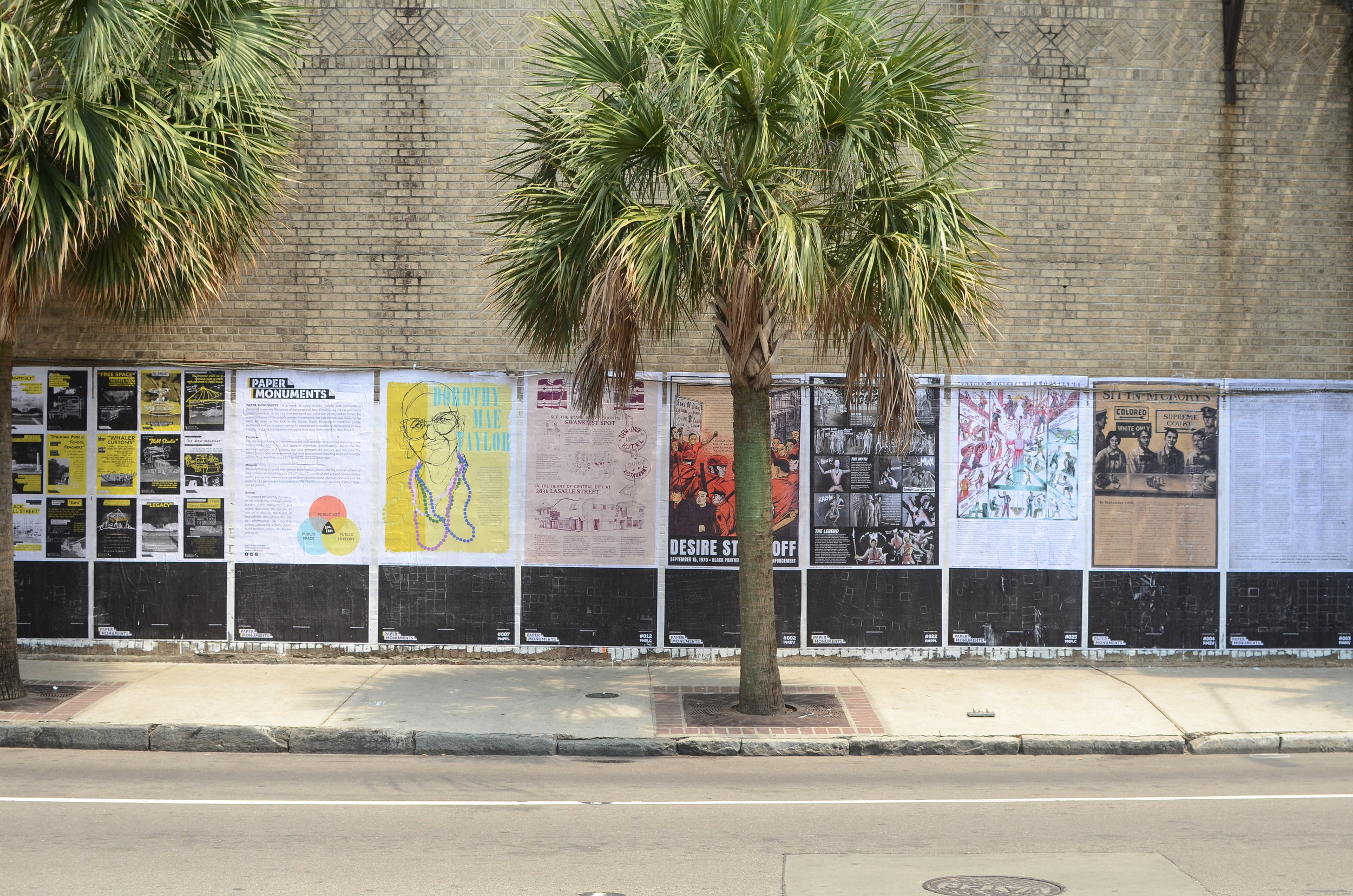 Completed poster and proposal installation panels at the Elk Place site.