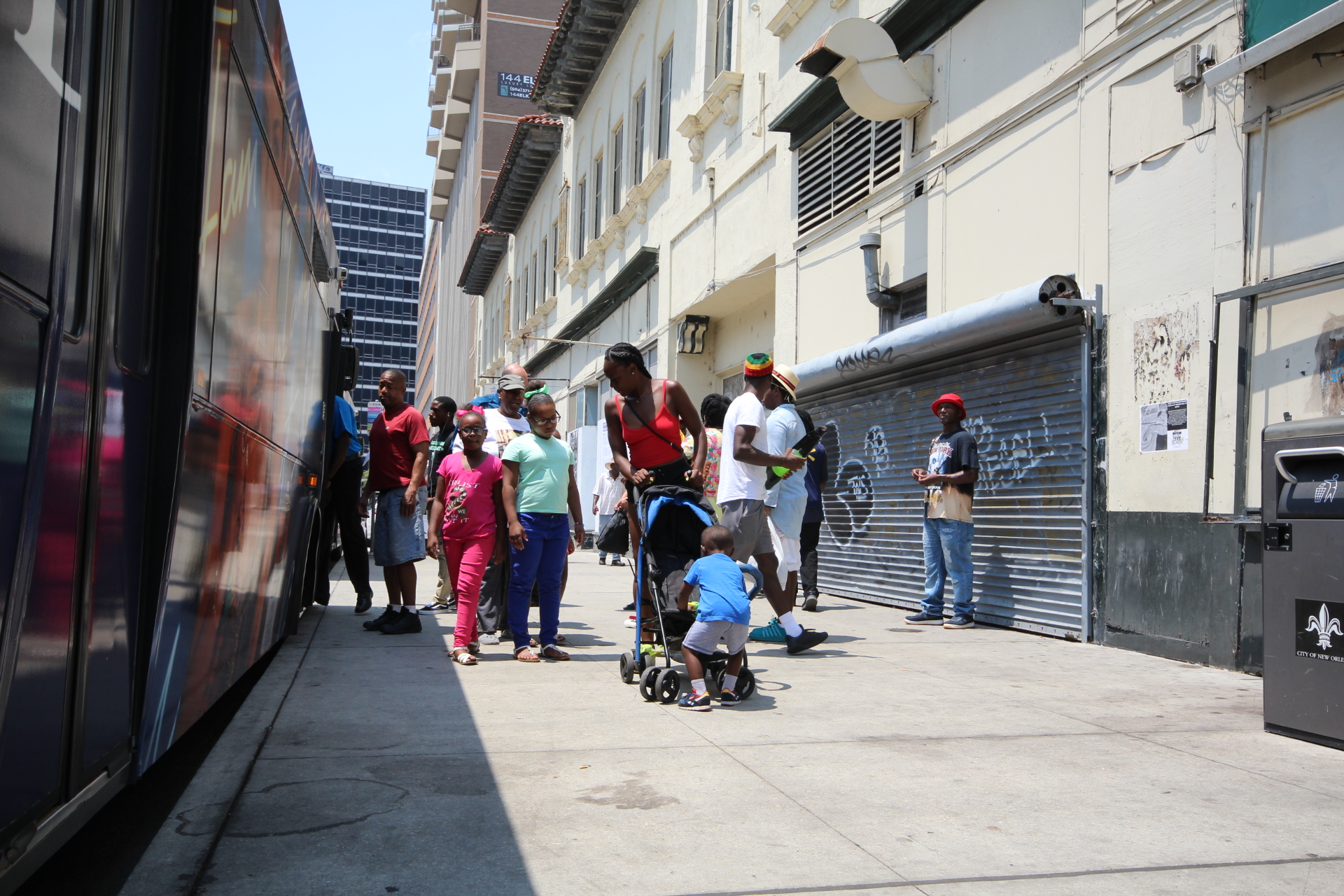 Riders exit a bus adjacent to the Rampart Street site.