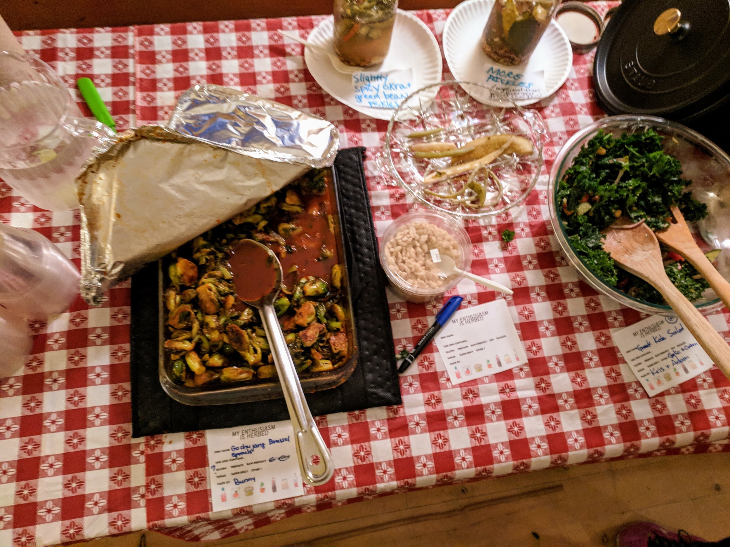 Just part of the spread that night, including bountiful kale salad, spicy brussels, excellent hummus, irresistible potatoes, bonus pickles, and so much more.