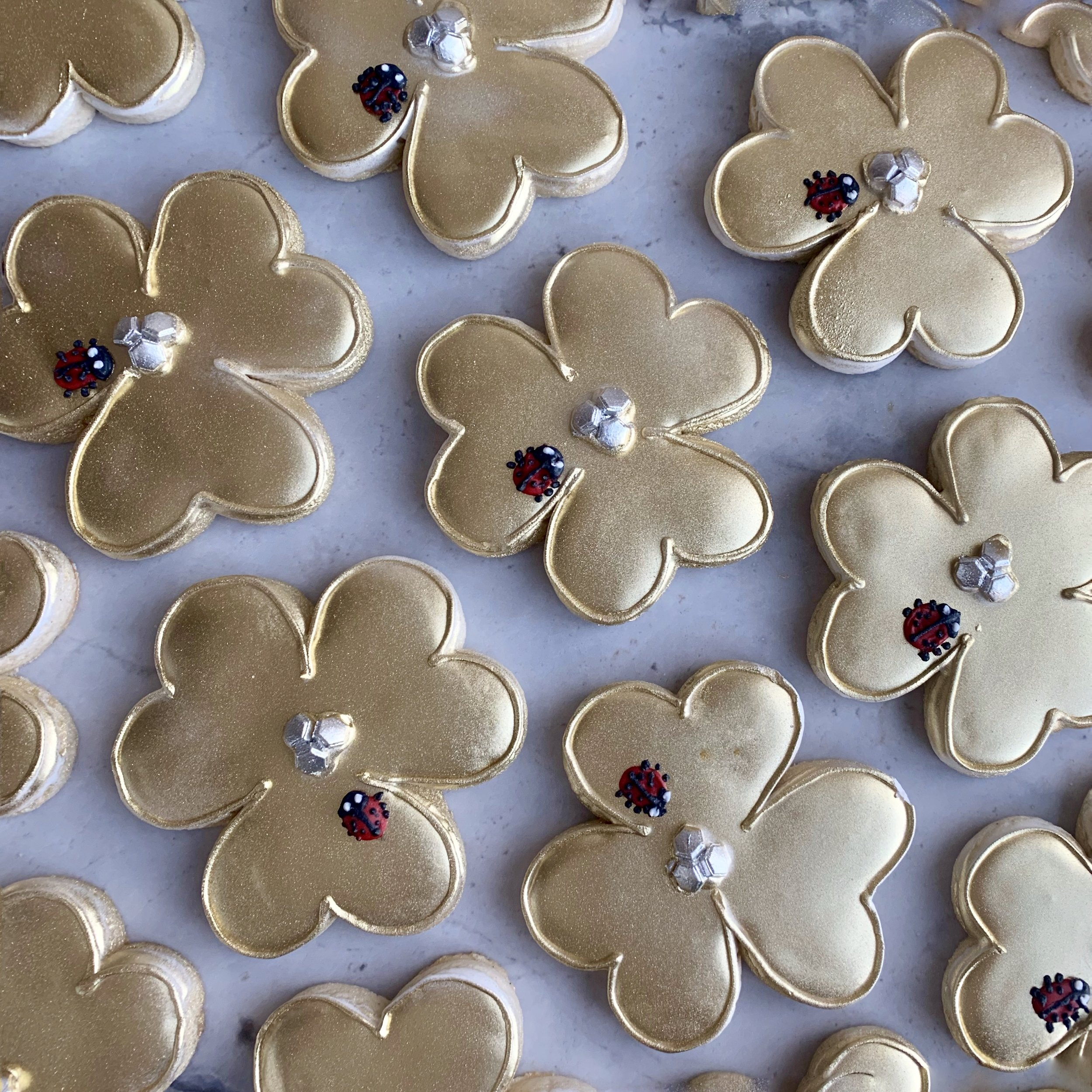 Custom cookies for the prestigious Van Cleef and Arpels - we created cookies to match a piece of their jewelry for their corporate event in 2019 -