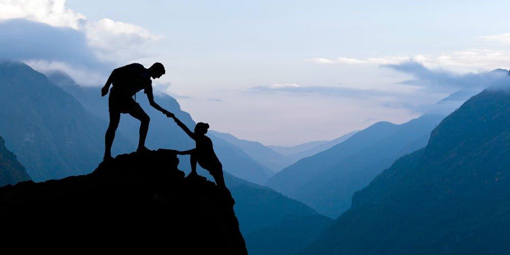 bigstock-Teamwork-Couple-Climbing-Helpi-91037114.jpg