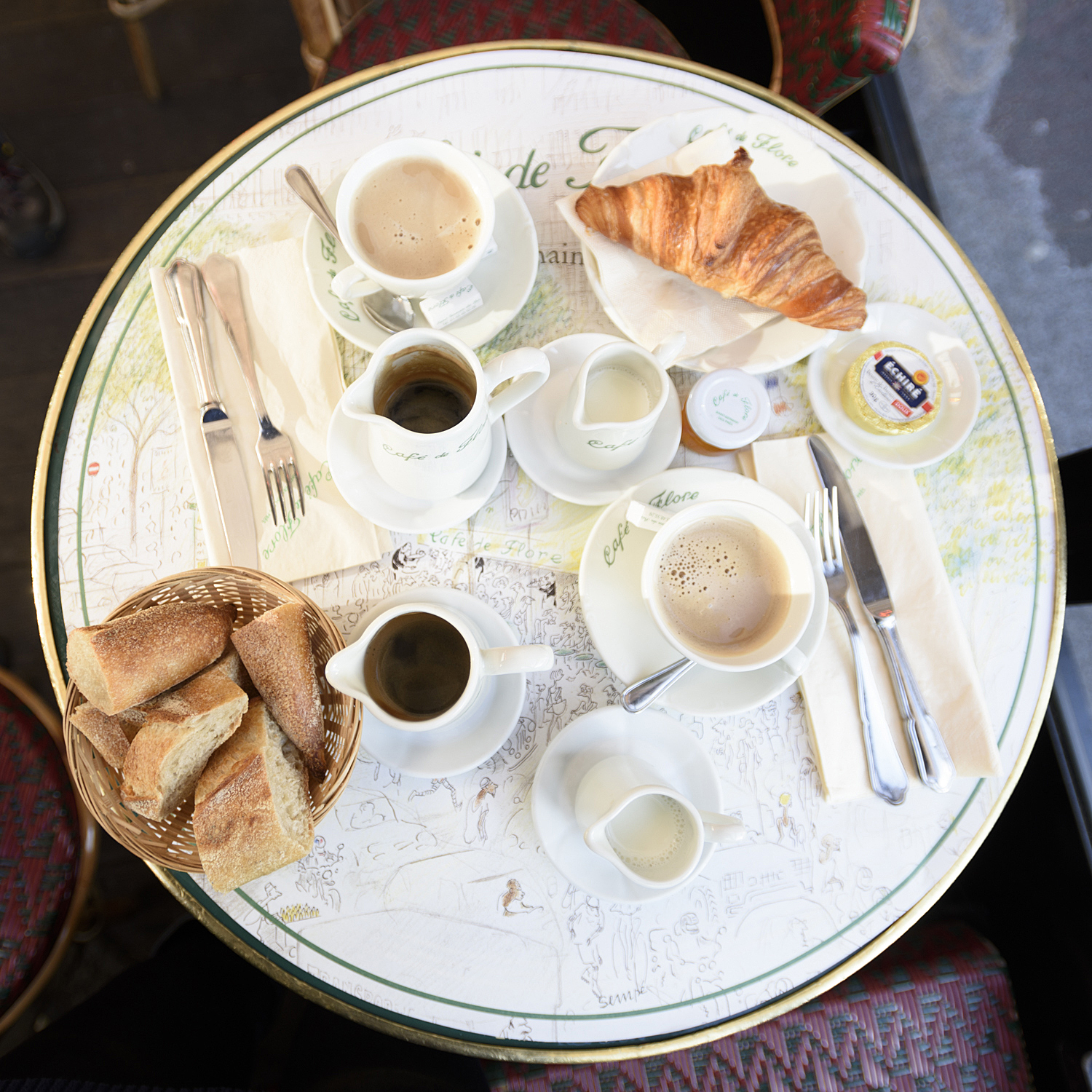 Breakfast for two at the Café de Flore, sitting outside on a spring day.