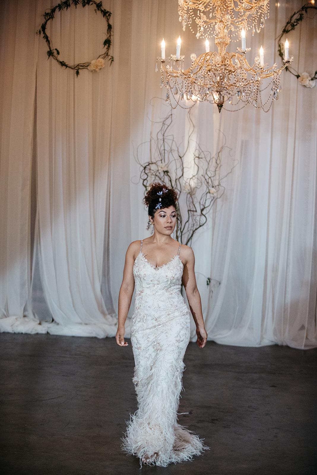 Model Curissa De'Leon wearing Enzoani.