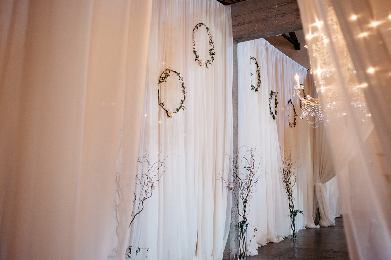 Drapery by Three Palms Events. Floral by Rodarte Floral Design.