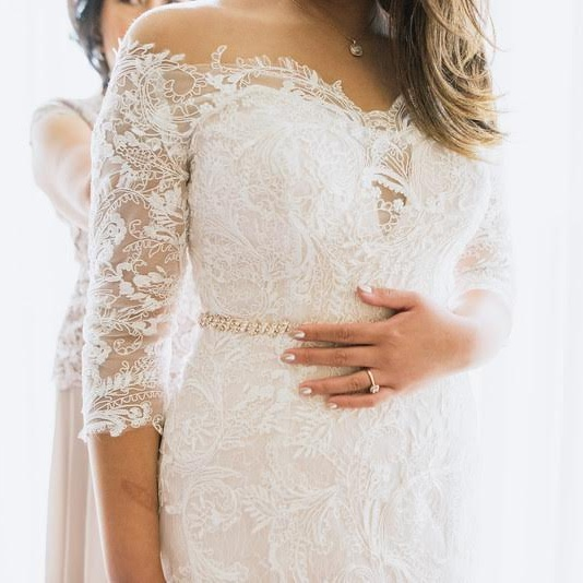 CUSTOM DESIGN & IN-HOUSE ALTERATIONS - Our experienced alterations team can customize and tailor your gown to perfection.