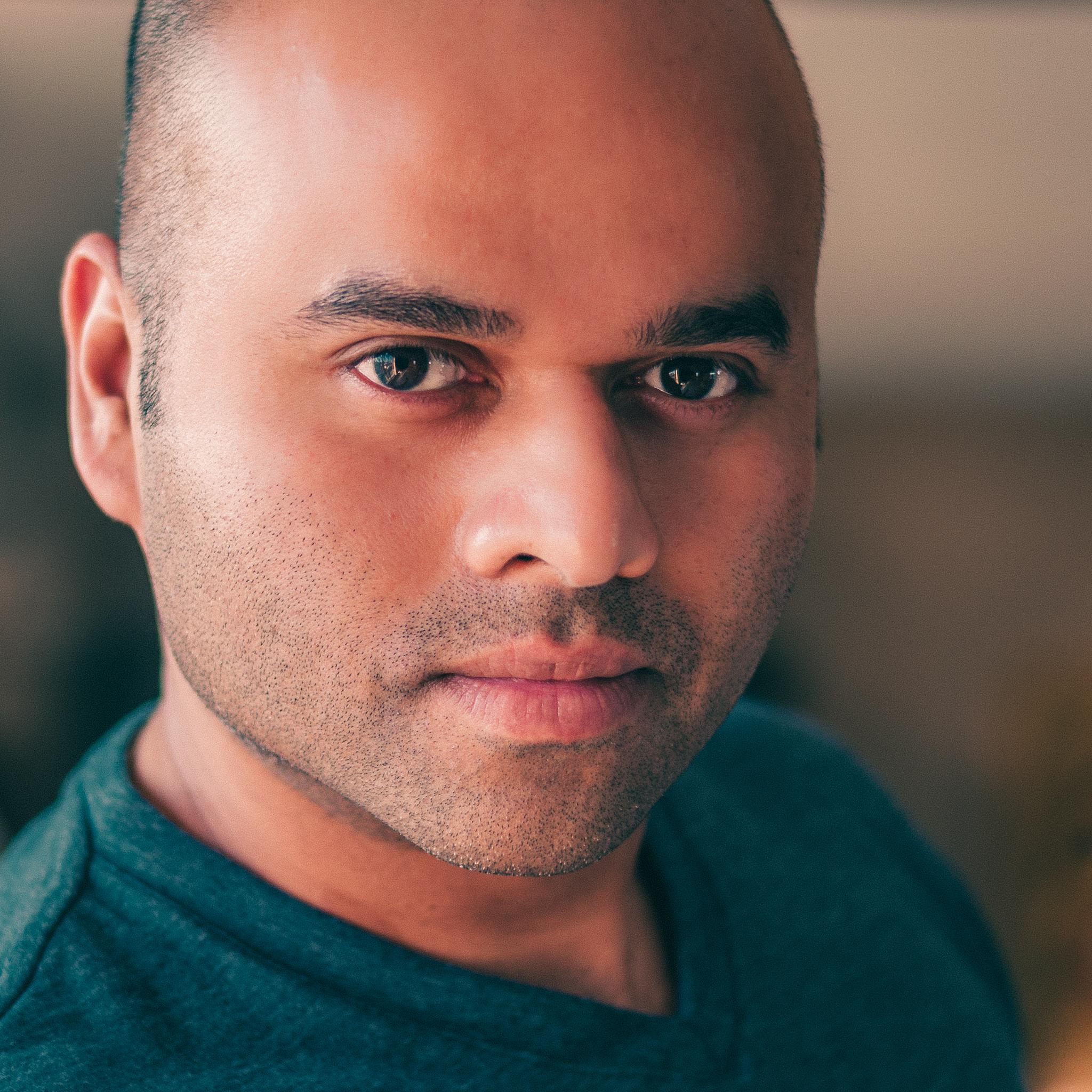 Reza headshot