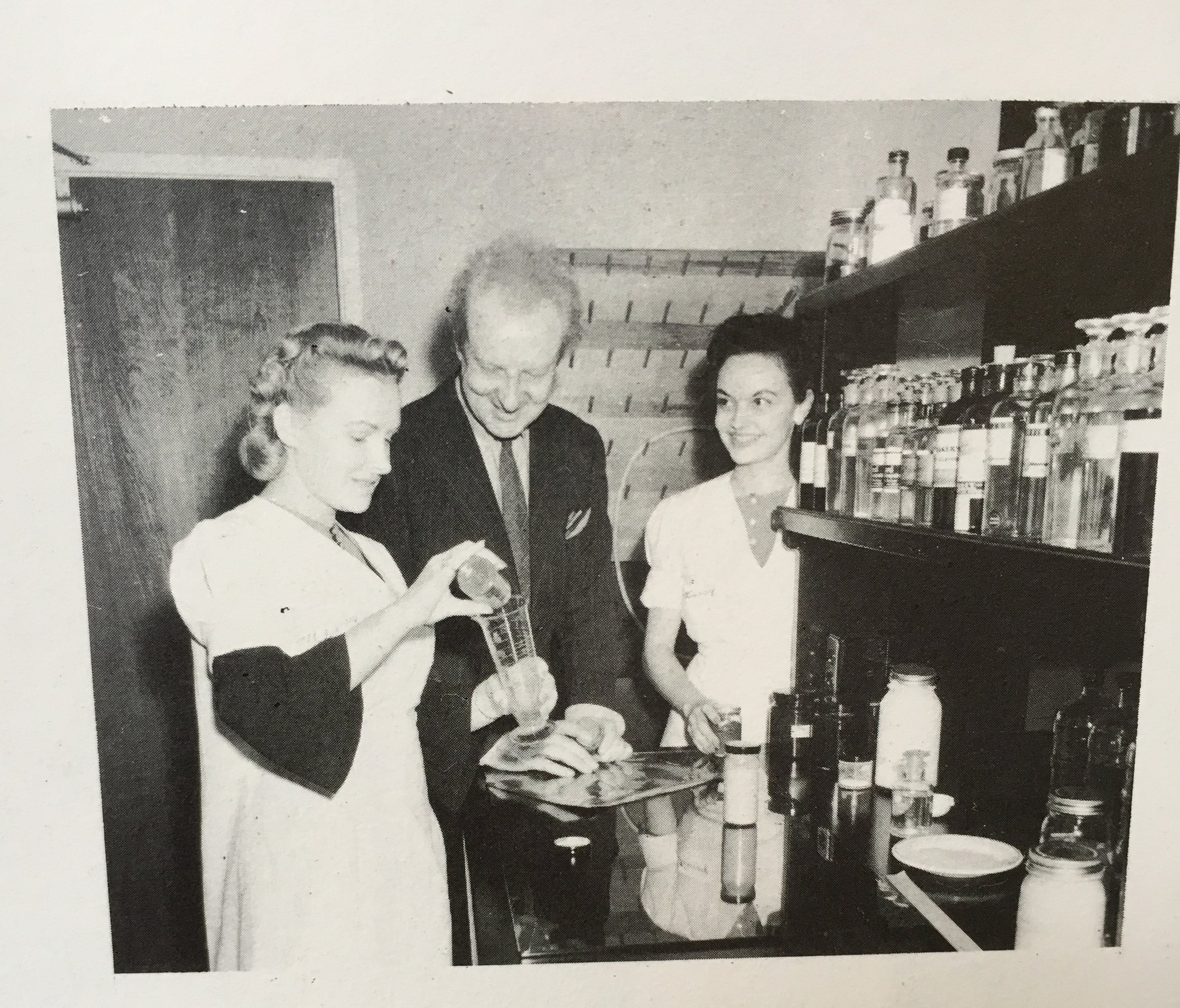 Conductor Leopold Stokowski visiting the Disney paint lab. Yes, the  paint lab .