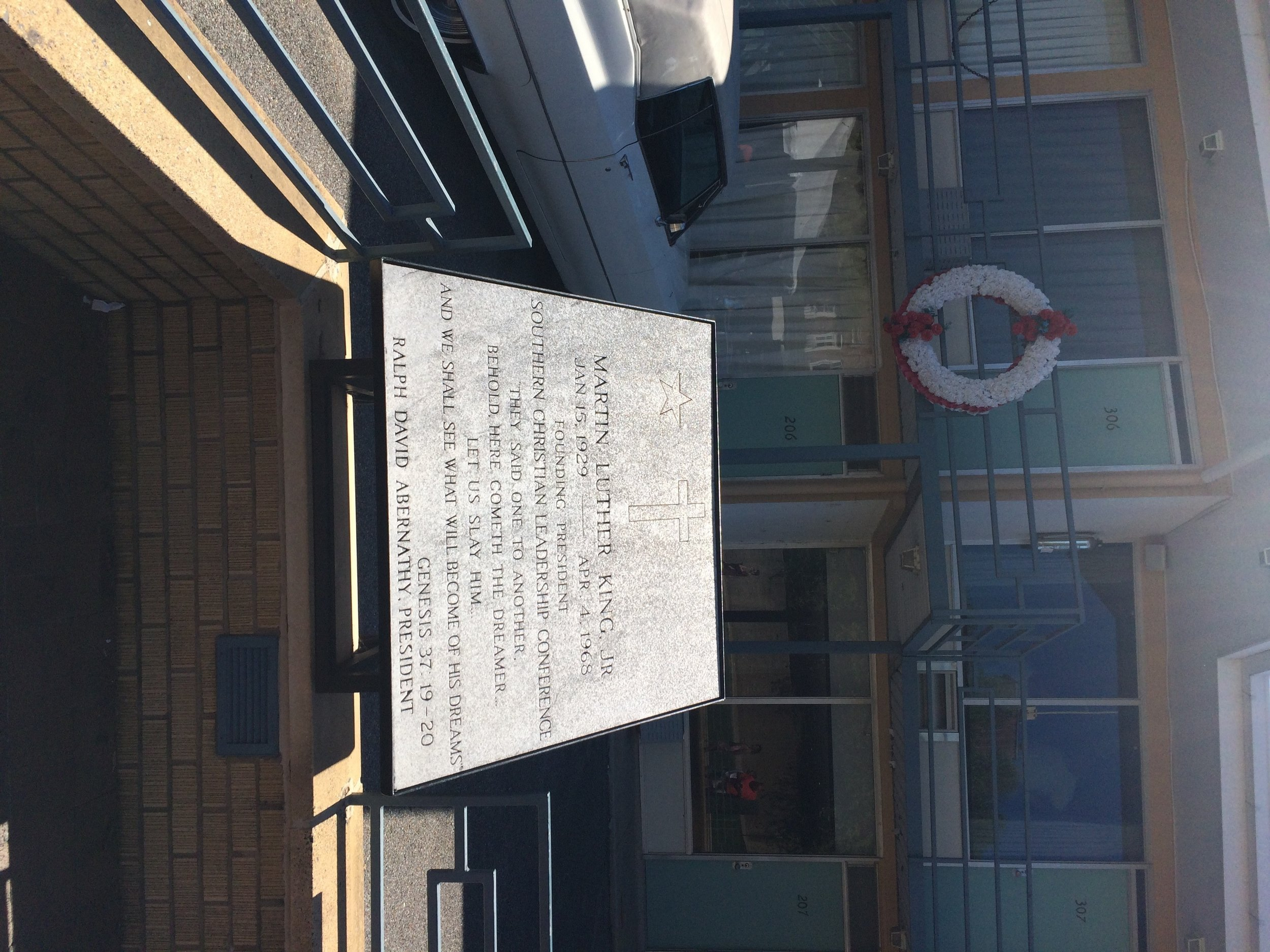a picture of the memorial and wreath dedicated to Martin Luther King Jr at the National Civil Rights Museum at the Lorraine Motel in Memphis