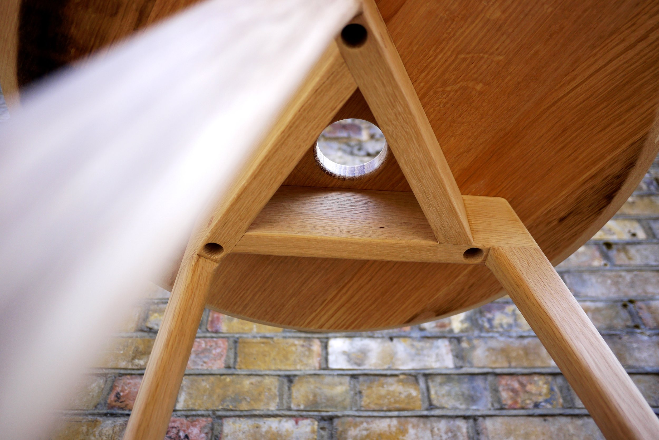 The bung hole allows for one-handed carry but was off centre so an interesting structure was developed around it.