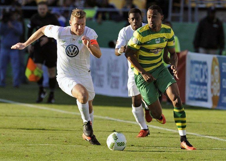 Jonathan Glenn  in action against German Bundesliga team  Vfl Wolfsburg .
