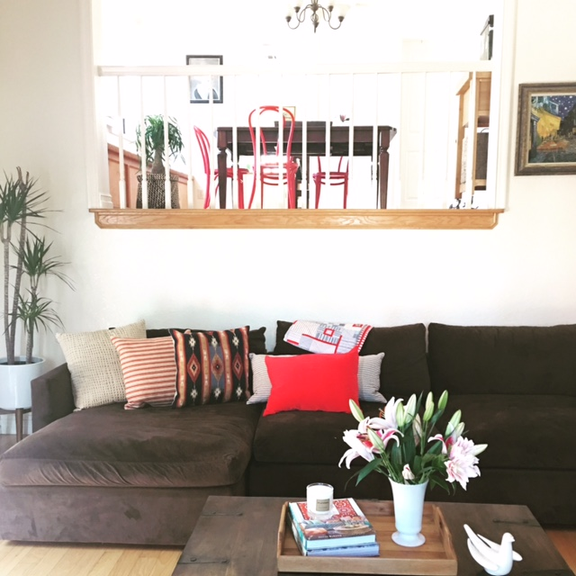 This project was a fun and quick refresh! We prepared the living and dining room for photos and an open house. With a quick declutter and the addition of fresh flowers, plants, artwork, throw pillows, and some funky red chairs… we updated this space to highlight the natural beauty of this spacious South Pasadena townhouse. Can you say SOLD??!!