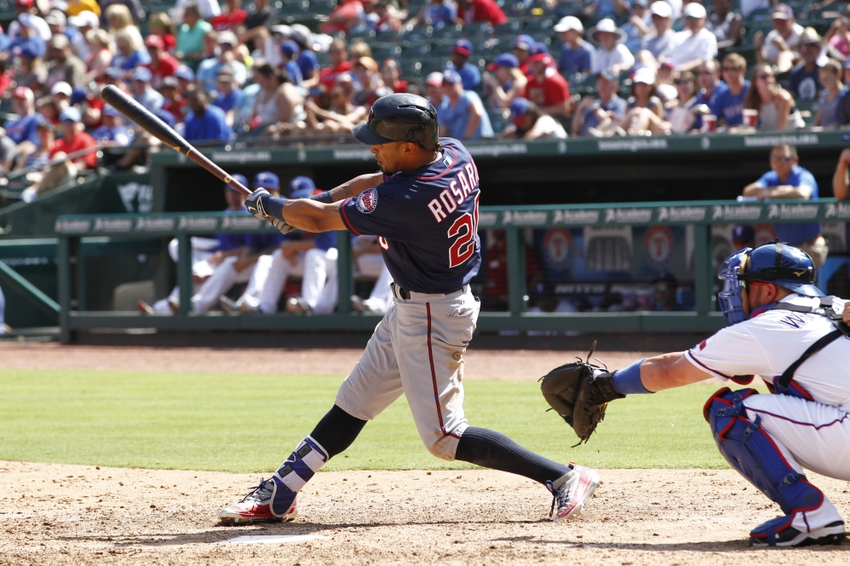 Jul 10, 2016; Arlington, TX, USA; Minnesota Twins center fielder Eddie Rosario (20) singles in a run in the seventh inning against the Texas Rangers at Globe Life Park in Arlington. Mandatory Credit: Tim Heitman-USA TODAY Sports