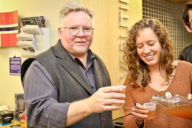 Photo: Anna Oksnevad Ross Johnson and Christina Melander sample the Julebrus at a recent Nordic Happy Hour.