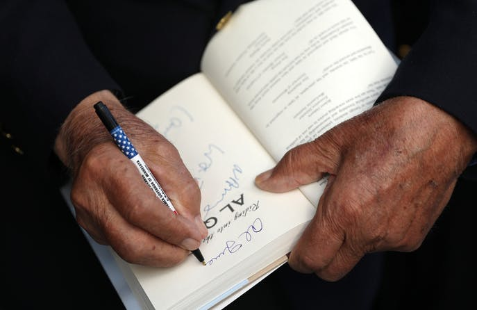 Former Gov. Al Quie signed a copy of his book for Nancy Rand prior to the dedication of the first Twin Cities building to be named in his honor, the education center at Norway House.